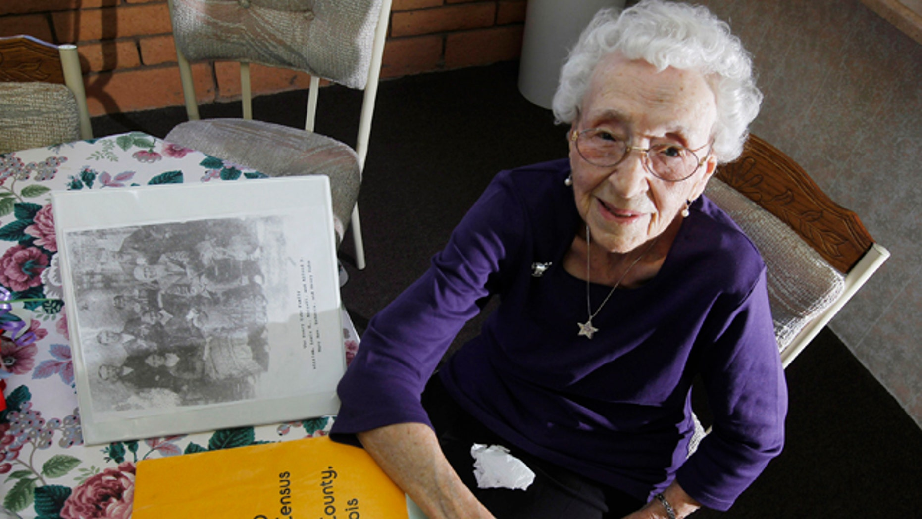 March 30, 2012: Verla Morris, who will turn 100 later this year, poses for a photograph as she goes through some of her family census data from the 19th and 20th centuries at her local residential senior center in Chandler, Ariz.