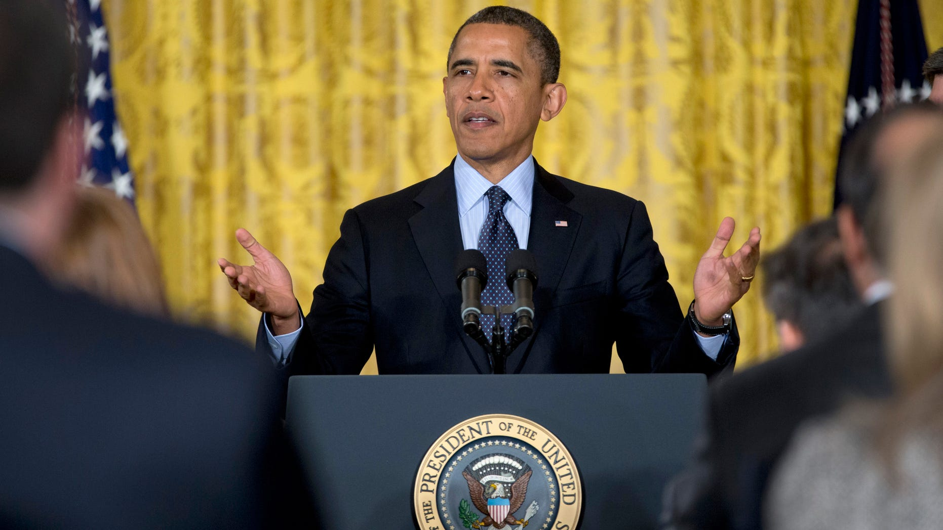 President Barack Obama gestures to the audience as he arrives in the East Room of the White House in Washington, Friday, Jan. 25, 2013, to announce that he will name current Deputy National Security Adviser Denis McDonough as his next chief of staff.  (AP Photo/Carolyn Kaster)