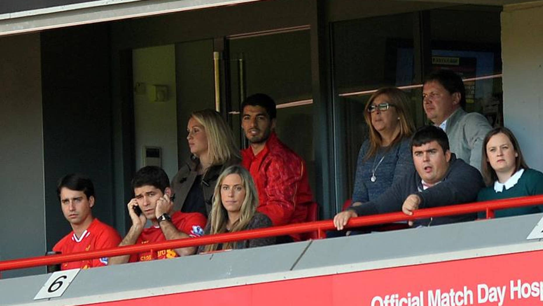 Liverpool's Luis Suarez watches from a hospitality box at Anfield stadium in Liverpool, on September 21, 2013.