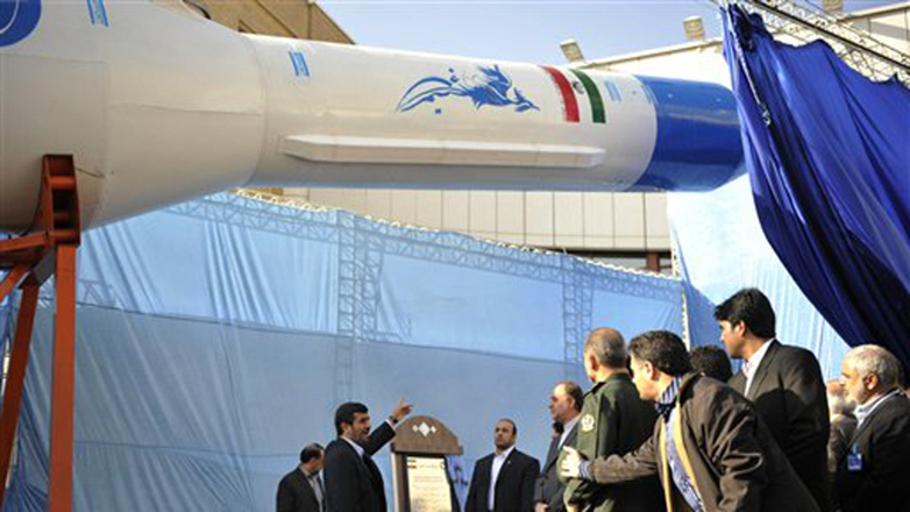 Feb. 3: Iranian President Mahmoud Ahmadinejad, center, gestures towards a model of Iran's domestically-built light booster rocket, named Simorgh -- part of an ambitious space program that has worried Western powers because they fear the same technology used to launch satellites could also deliver warheads.