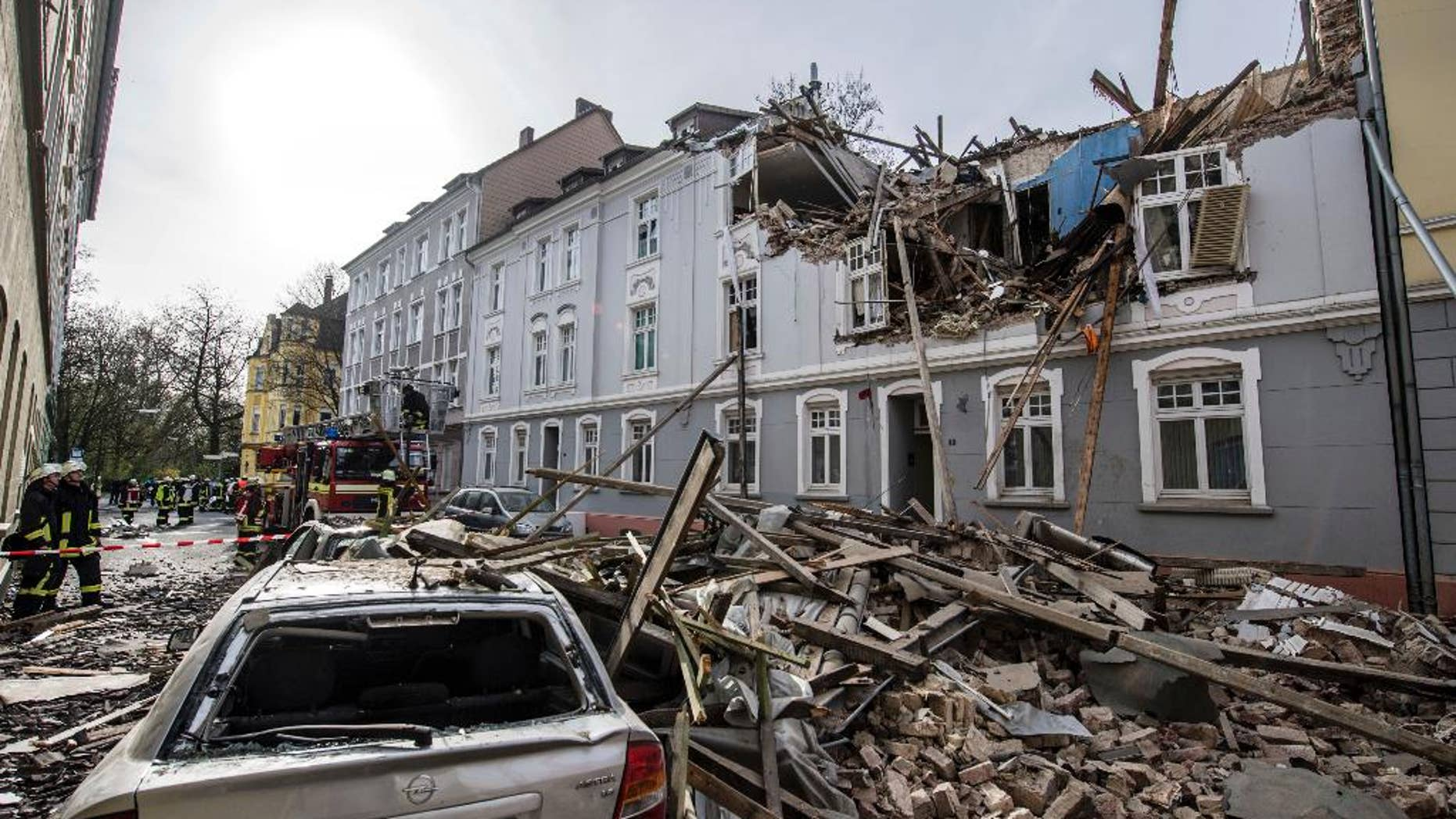 Debris sits on a street after an explosion in an  apartment building in Dortmund, western Germany, Friday, March 31, 2017. Police said one person was injured, another person is still missing. (Bernd Thissen/dpa via AP)