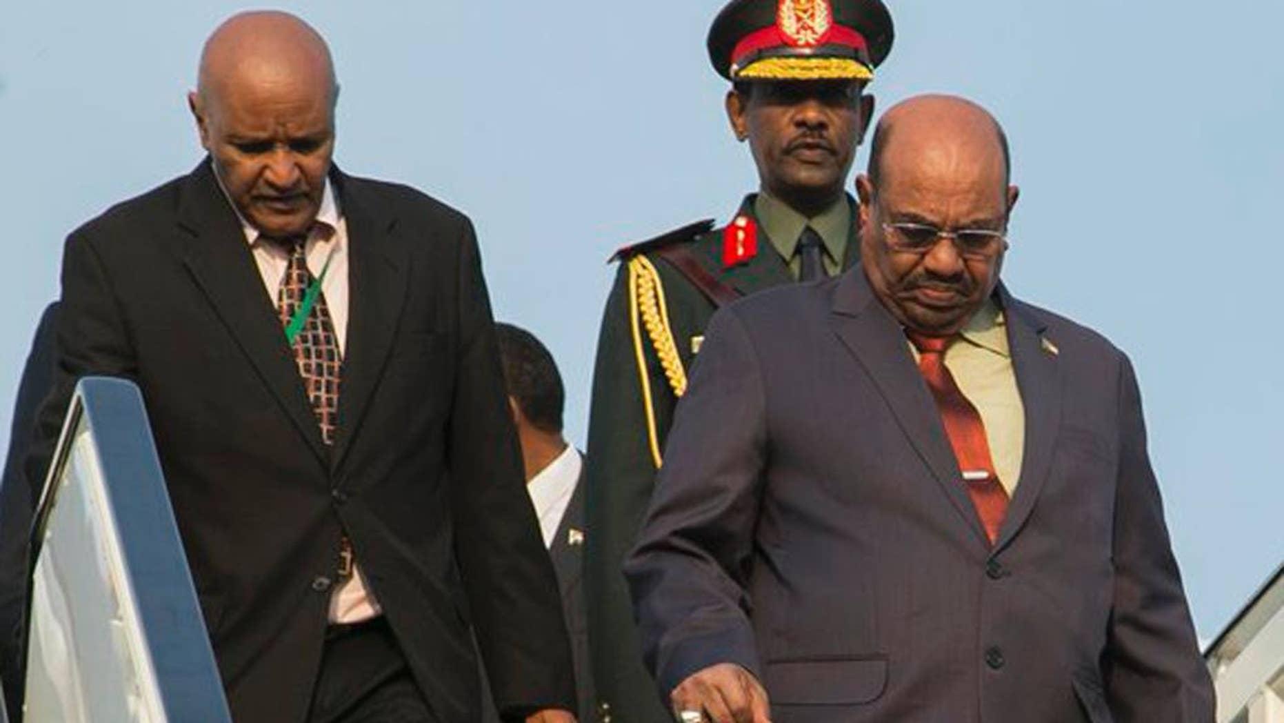 Sudan president Omar al-Bashir, right, arrives in Kigali, capital of Rwanda, Saturday, July 16, 2016. Al-Bashir arrived in Rwanda to attend a summit of African leaders, defying an international warrant of arrest after public assurances from Rwandan leaders that he would not be arrested. (AP Photo/Ssuuna katera)