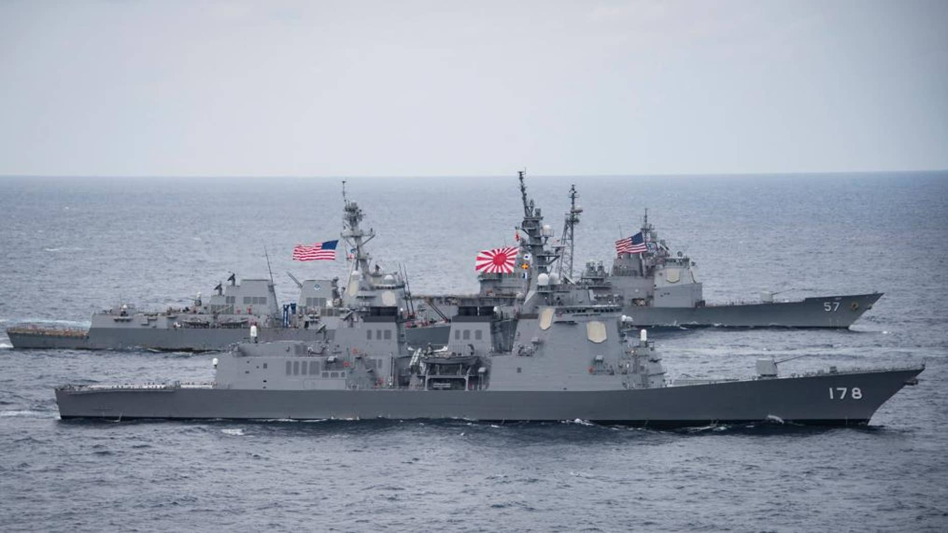In this Friday, April 28, 2017 photo released by the U.S. Navy, the Japan Maritime Self-Defense Force destroyer JS Ashigara (DDG 178), foreground, the Arleigh Burke-class guided-missile destroyer USS Wayne E. Meyer (DDG 108), center, and the Ticonderoga-class guided-missile cruiser USS Lake Champlain (CG 57) transit the Philippine Sea as they accompany the Nimitz-class aircraft carrier USS Carl Vinson (CVN 70) for the ongoing joint exercises. (Mass Communication Specialist 2nd Class Z.A. Landers/U.S. Navy via AP)