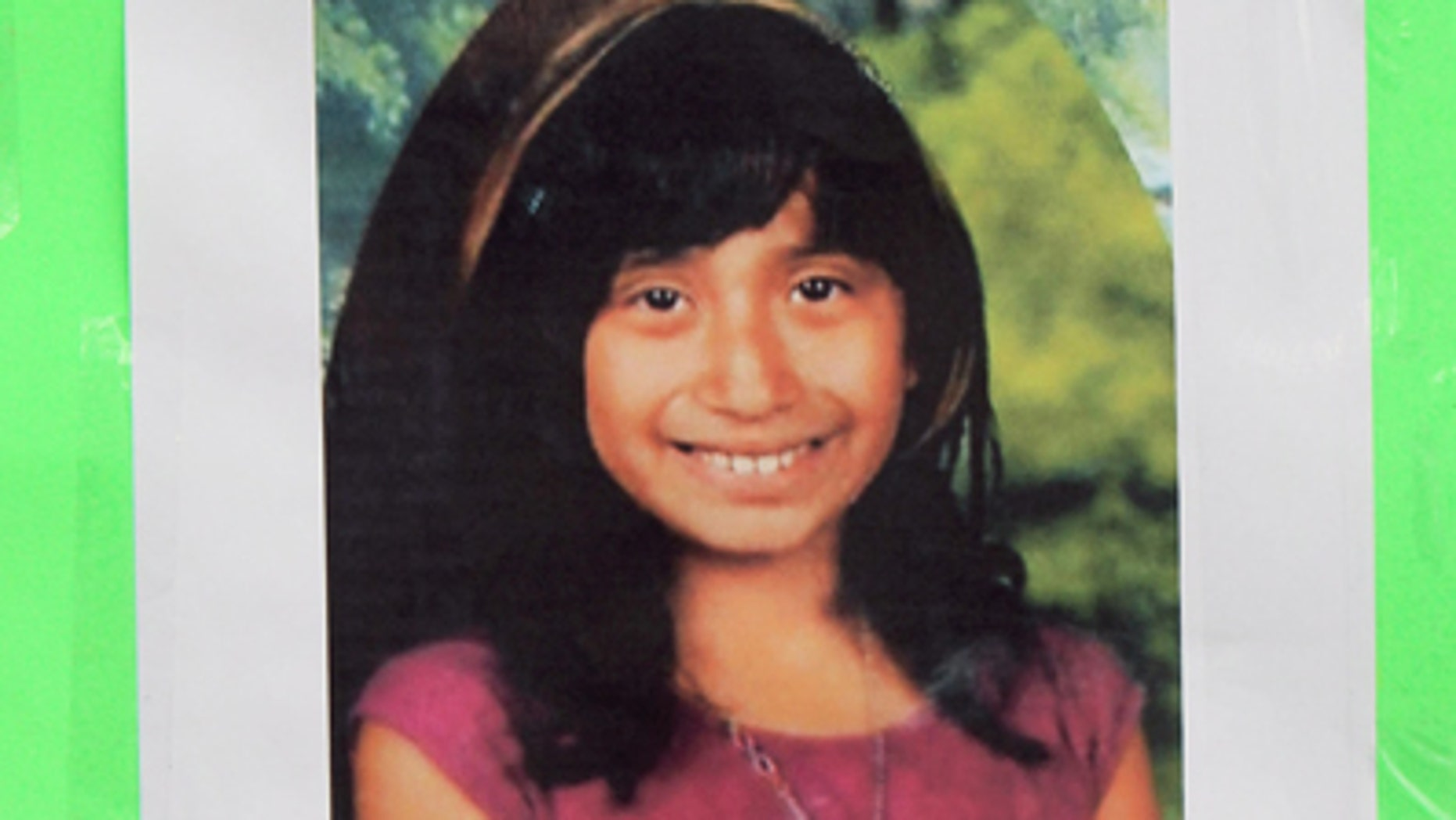 Feb. 27, 2012: A photo of Joanna Ramos, 11,with a note, is left at a memorial outside Willard Elementary school  in Long Beach, Calif.  Ramos, who died after a fight with another 11-year-old in an alley near their elementary school underwent emergency surgery for a blood clot on her brain before her death, her sister said Monday.