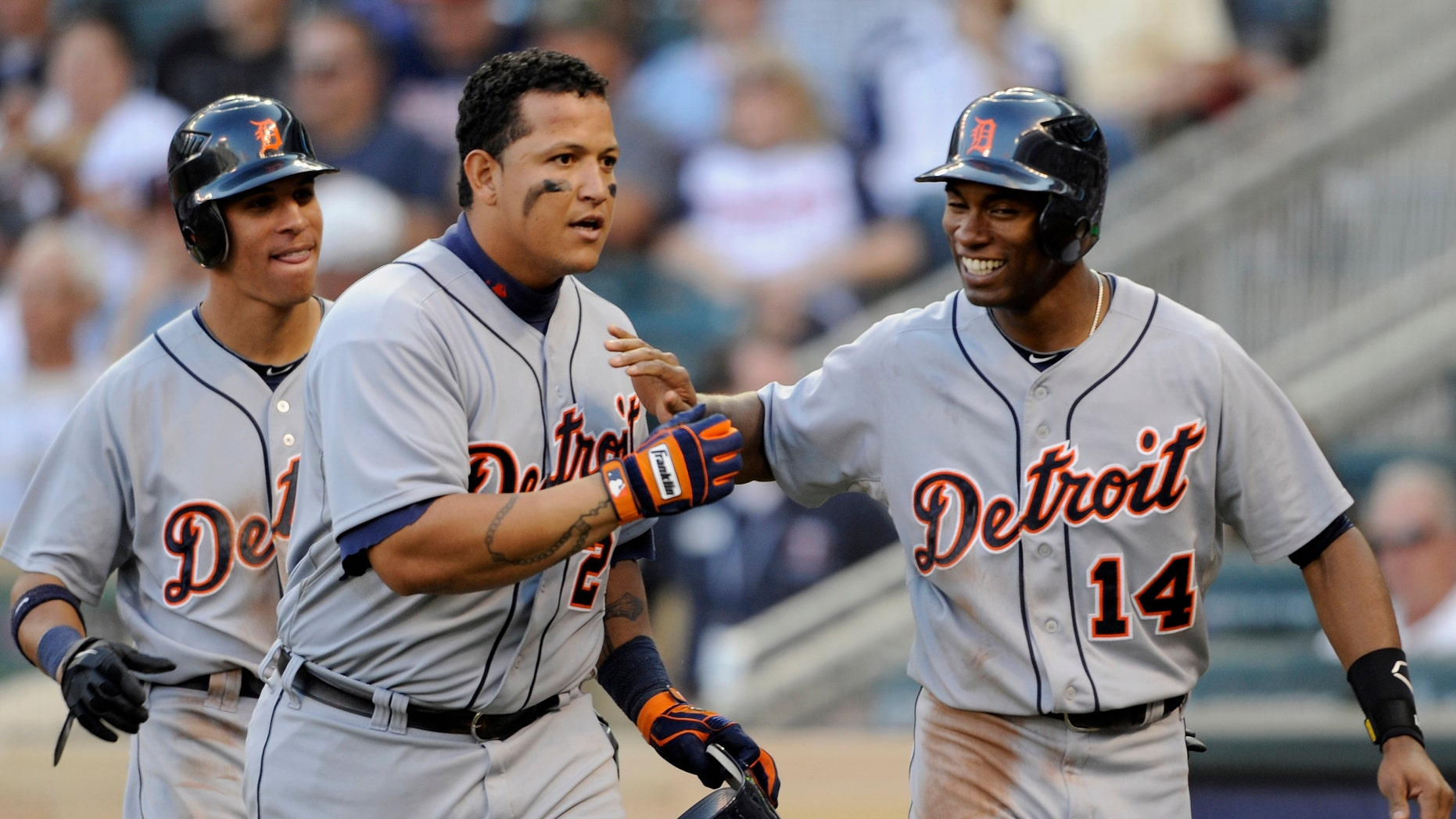 MINNEAPOLIS, MN - SEPTEMBER 29: Quintin Berry #52 and Austin Jackson #14 of the Detroit Tigers congratulate Miguel Cabrera #24 on a three run home run against the Minnesota Twins during the eighth inning of the game on September 29, 2012 at Target Field in Minneapolis, Minnesota. The Tigers defeated the Twins 6-4. (Photo by Hannah Foslien/Getty Images)