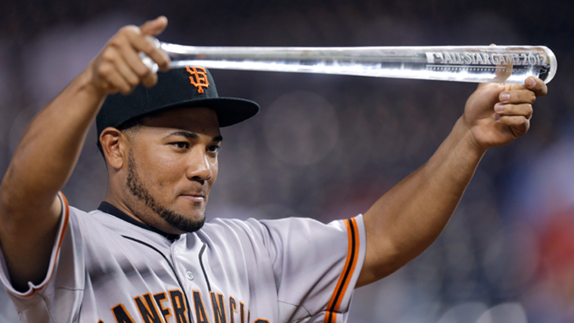 July 10, 2012: Melky Cabrera, of the San Francisco Giants, showing off his MVP trophy after the MLB All-Star baseball game in Kansas City, Mo.