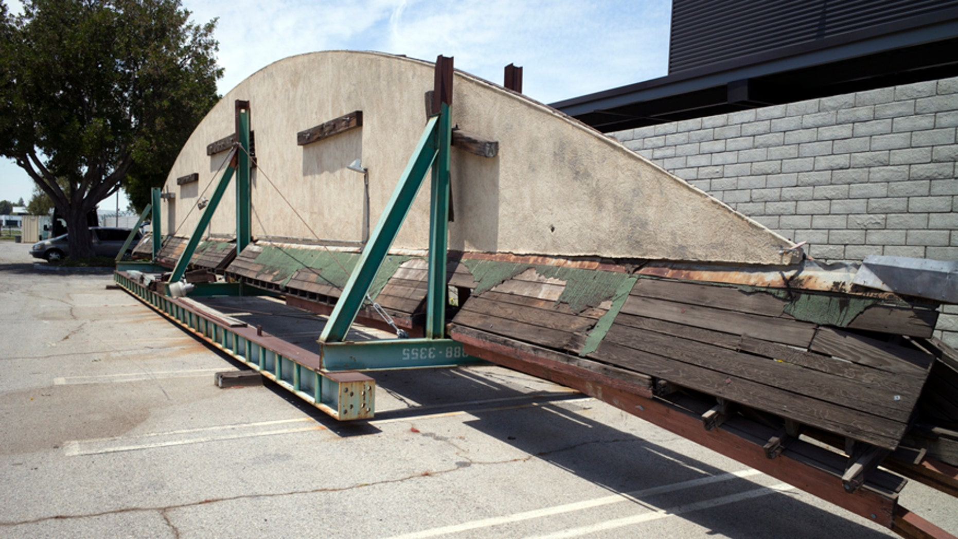 """This May 23, 2017, photo shows part of the disassembled hangar facade that framed the opening scene of the 1942 film """"Casablanca,"""" where it is stored in a parking lot at Van Nuys Airport in Los Angeles' San Fernando Valley. Christine Dunn, who with her late husband recovered the hangar 10 years ago, told the Daily News on Sunday, May 28, that it'll be moved to Valley Relics Museum, home to many pop culture items."""