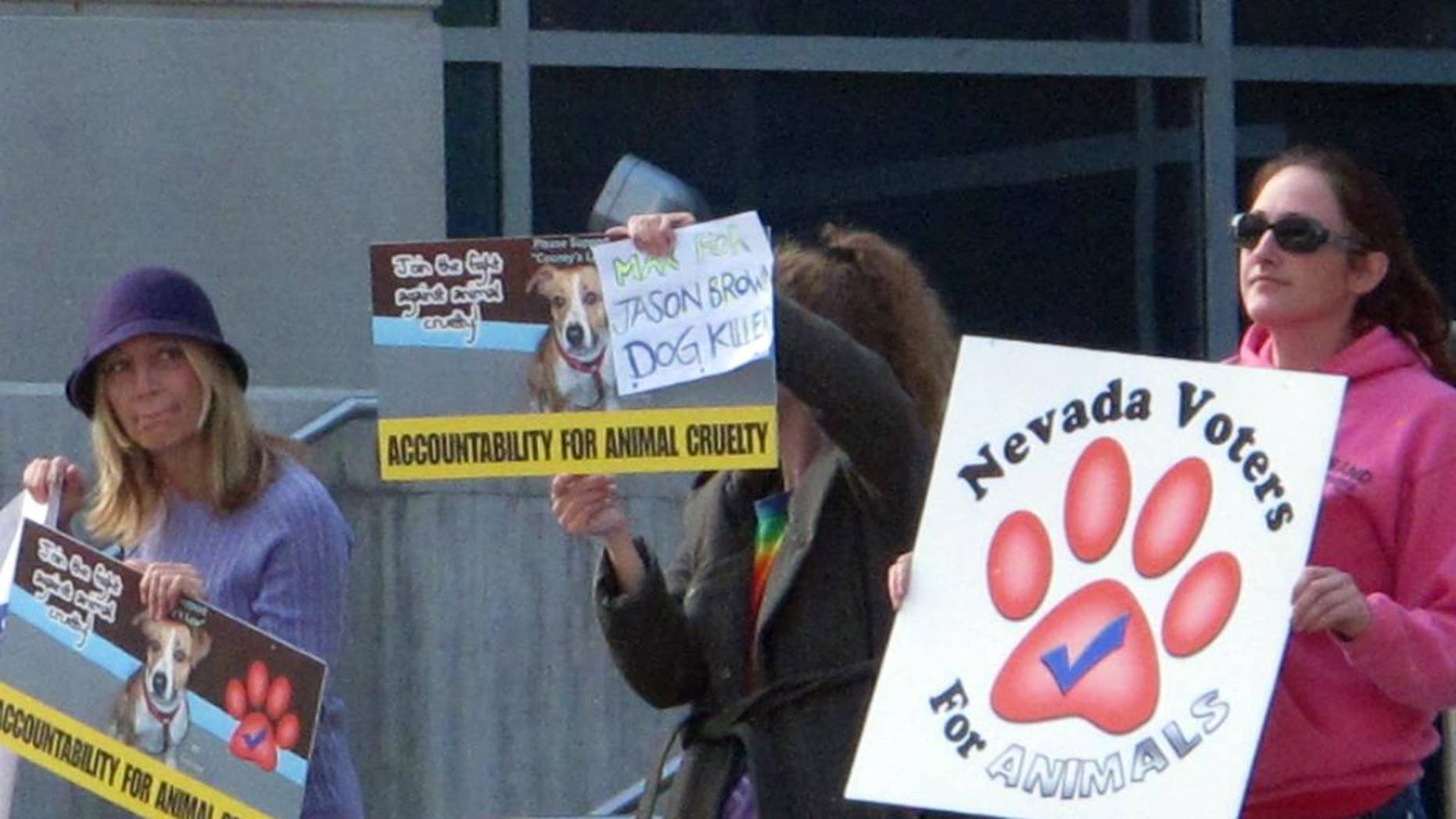 A half dozen animal rights activists protested Thursday, Oct. 16, 2014, outside Reno Justice Court where Jason Brown, 24, was to appear later in the day at a status hearing on charges accusing him of torturing and killing several dogs in July. Leaders of Nevada Voters for Animals are urging the maximum punishment if Brown is convicted of all seven counts, which could total more than 20 years in prison. (AP Photo/Scott Sonner).
