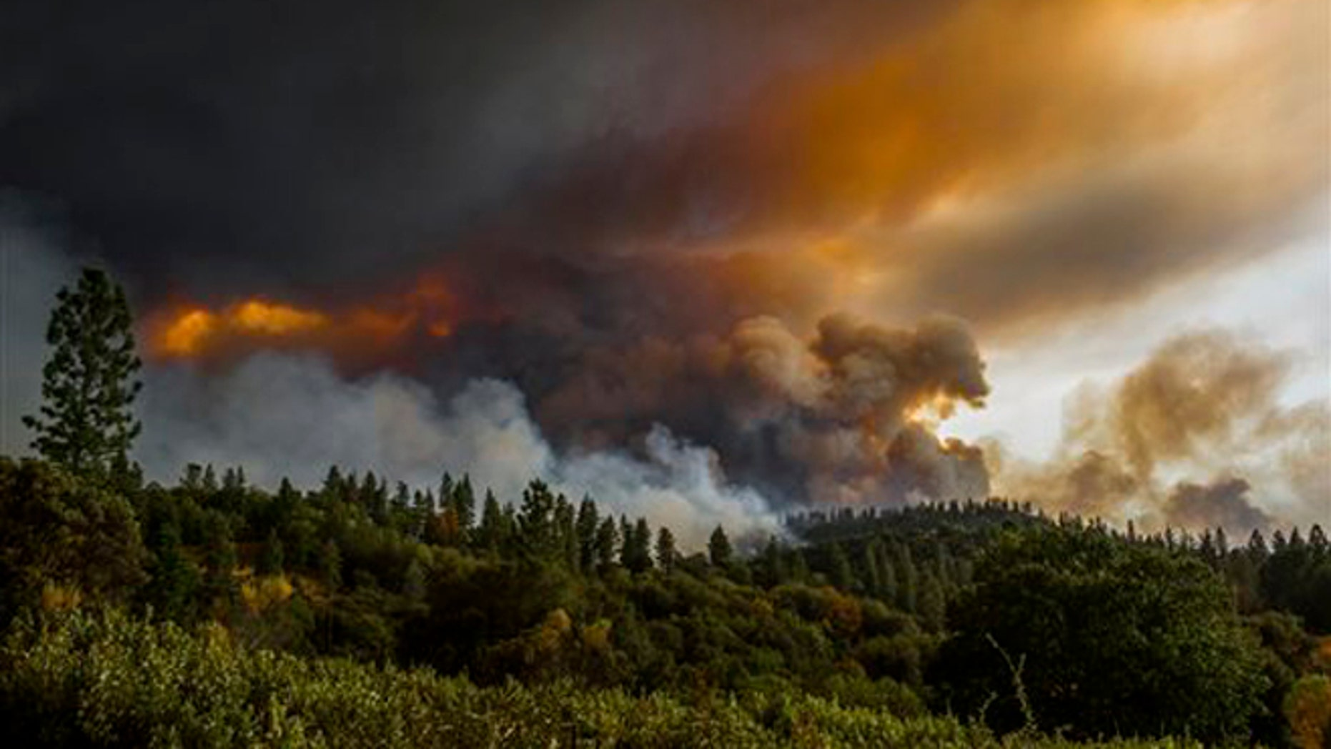 Sept. 10, 2015: Smoke rises from a fire near Butte Mountain Road near Jackson, Calif.