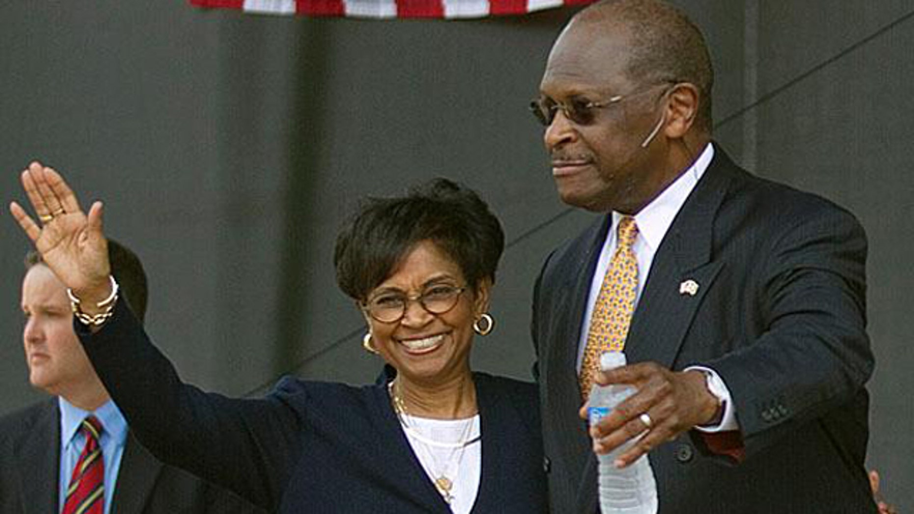 May 21, 2011: Herman Cain and his wife, Gloria, wave during his presidential campaign kickoff in Atlanta.