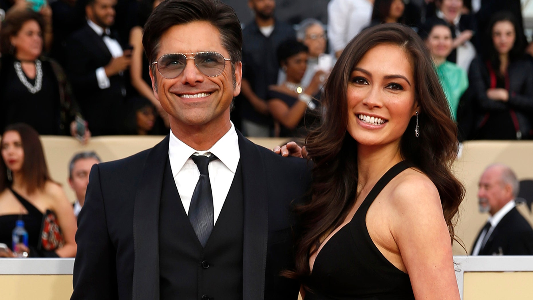 Actor John Stamos and Caitlin McHugh at the 24th Screen Actors Guild Awards.