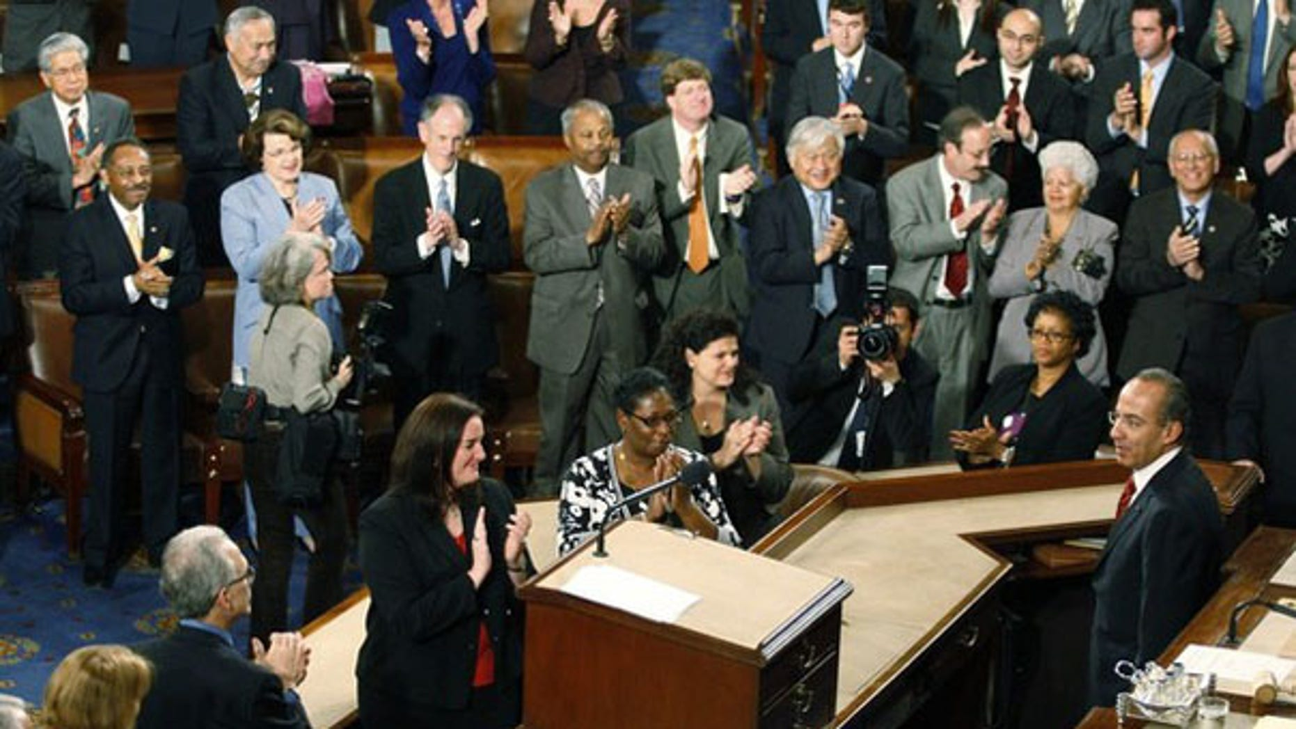 Mexican President Felipe Calderon is applauded during his speech on Capitol Hill May 20. (Reuters Photo)
