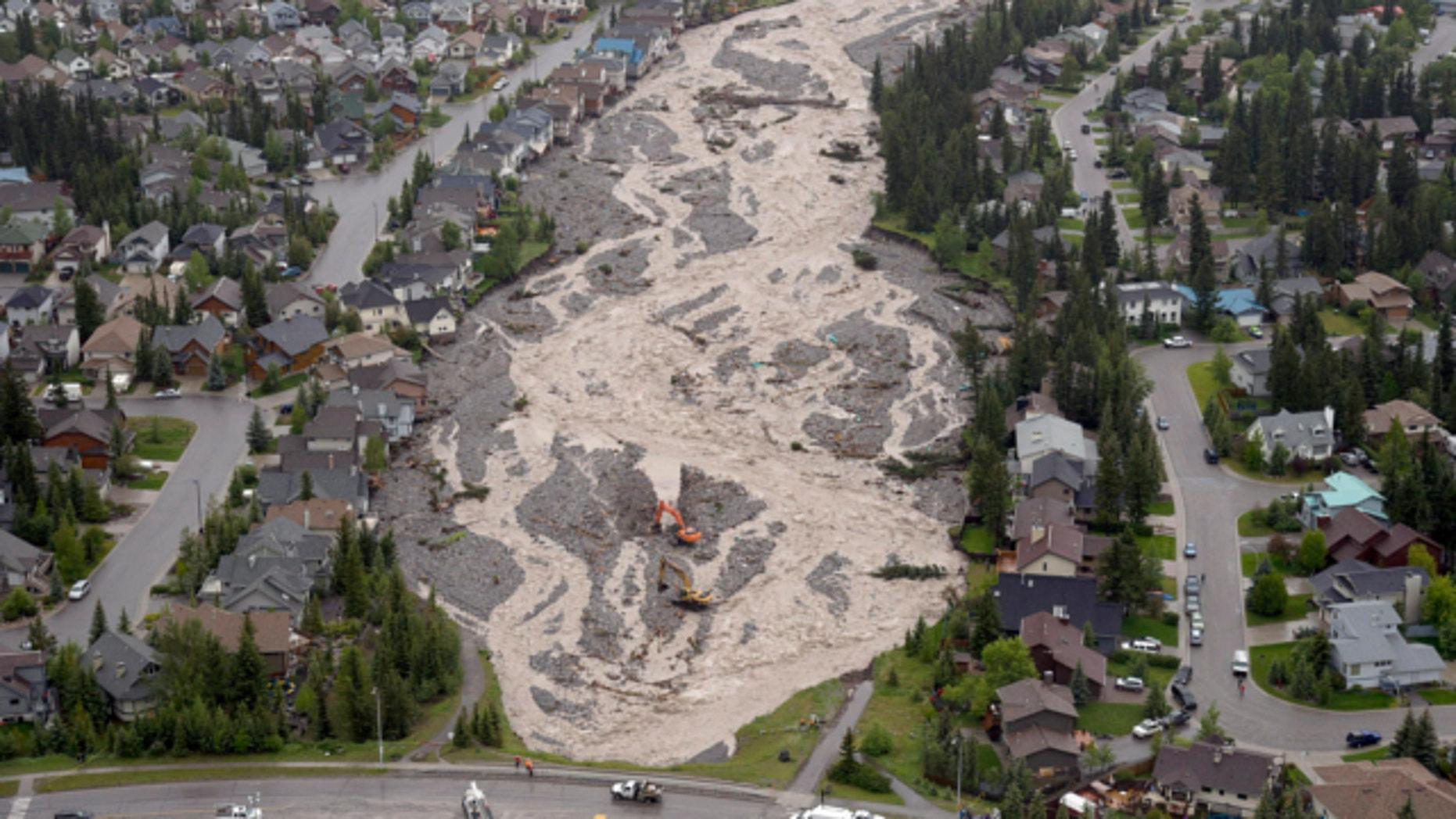 June 21, 2013: The flooded Cougar Creek runs through Canmore, Alberta.