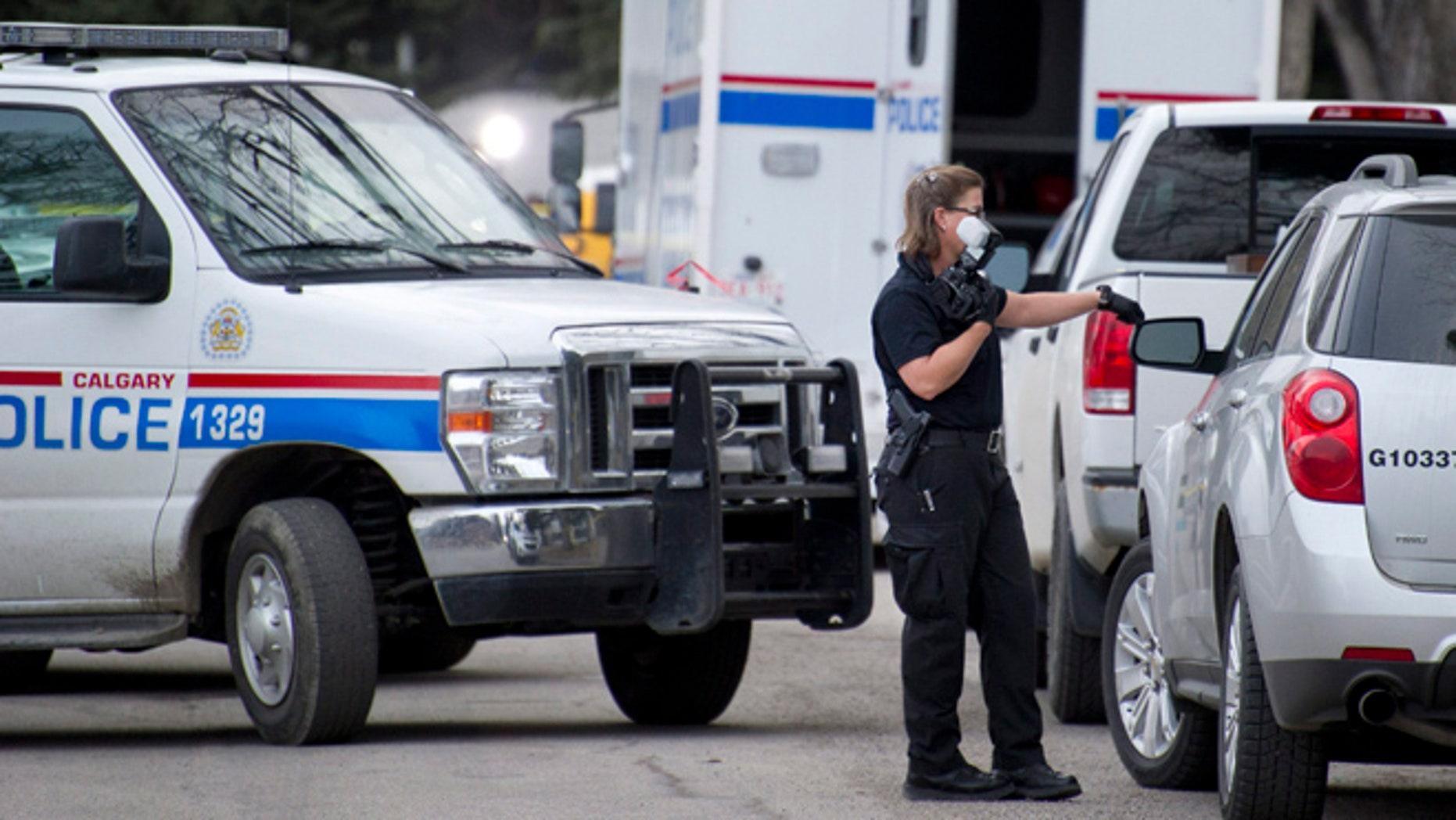 Apr. 15, 2014: Police investigate the scene of a multiple fatal stabbing in northwest Calgary, Alberta.