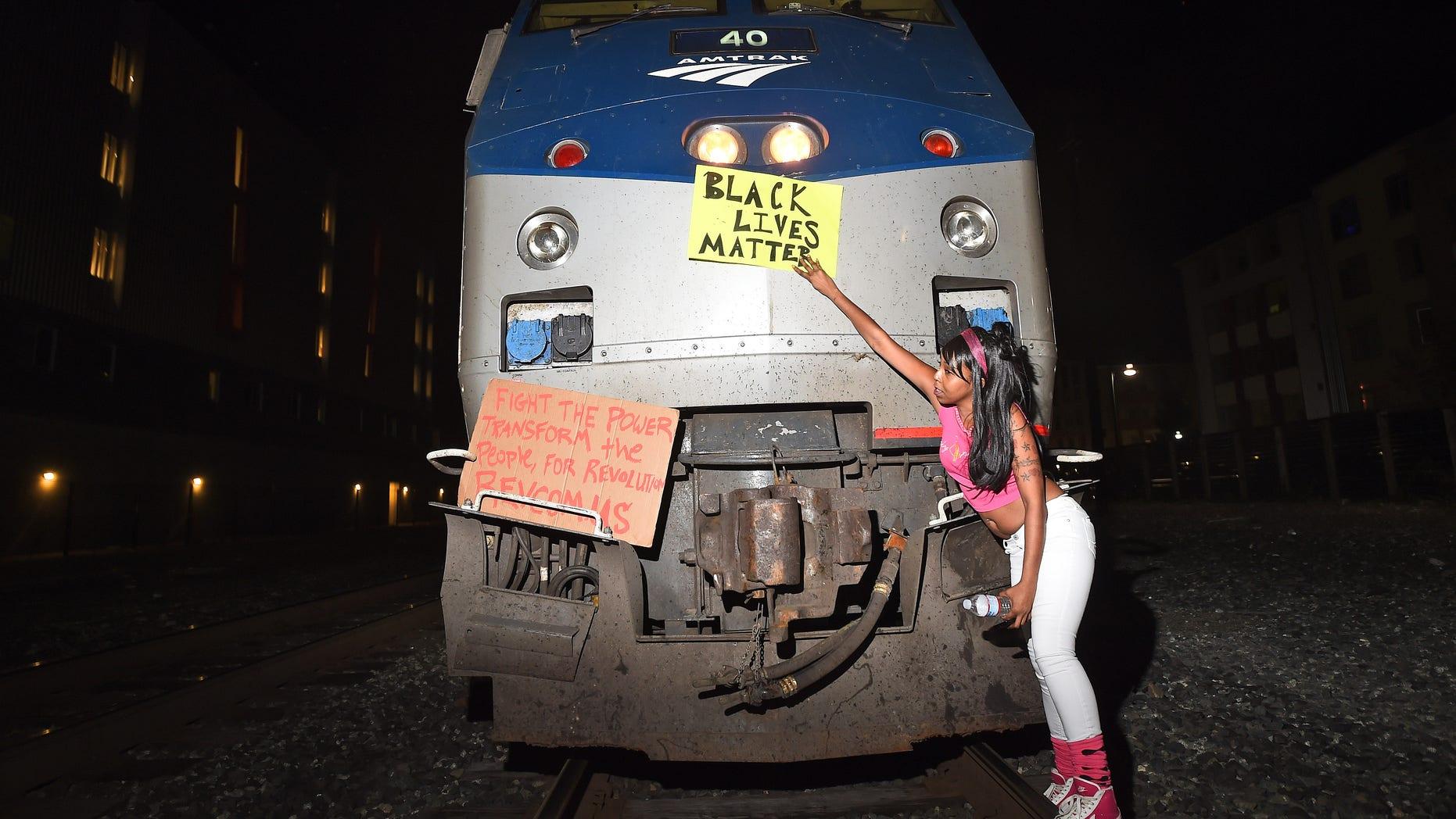 Dec. 8, 2014: Protesters block an Amtrak passenger train in Berkeley, Calif.