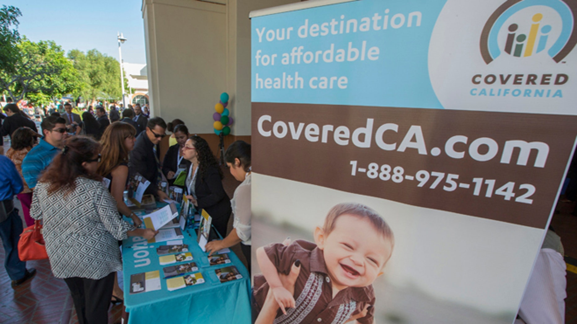 Oct. 1, 2013: People sign up for health insurance information at a Covered California event which marks the opening of the state's Affordable Healthcare Act, commonly known as Obamacare.