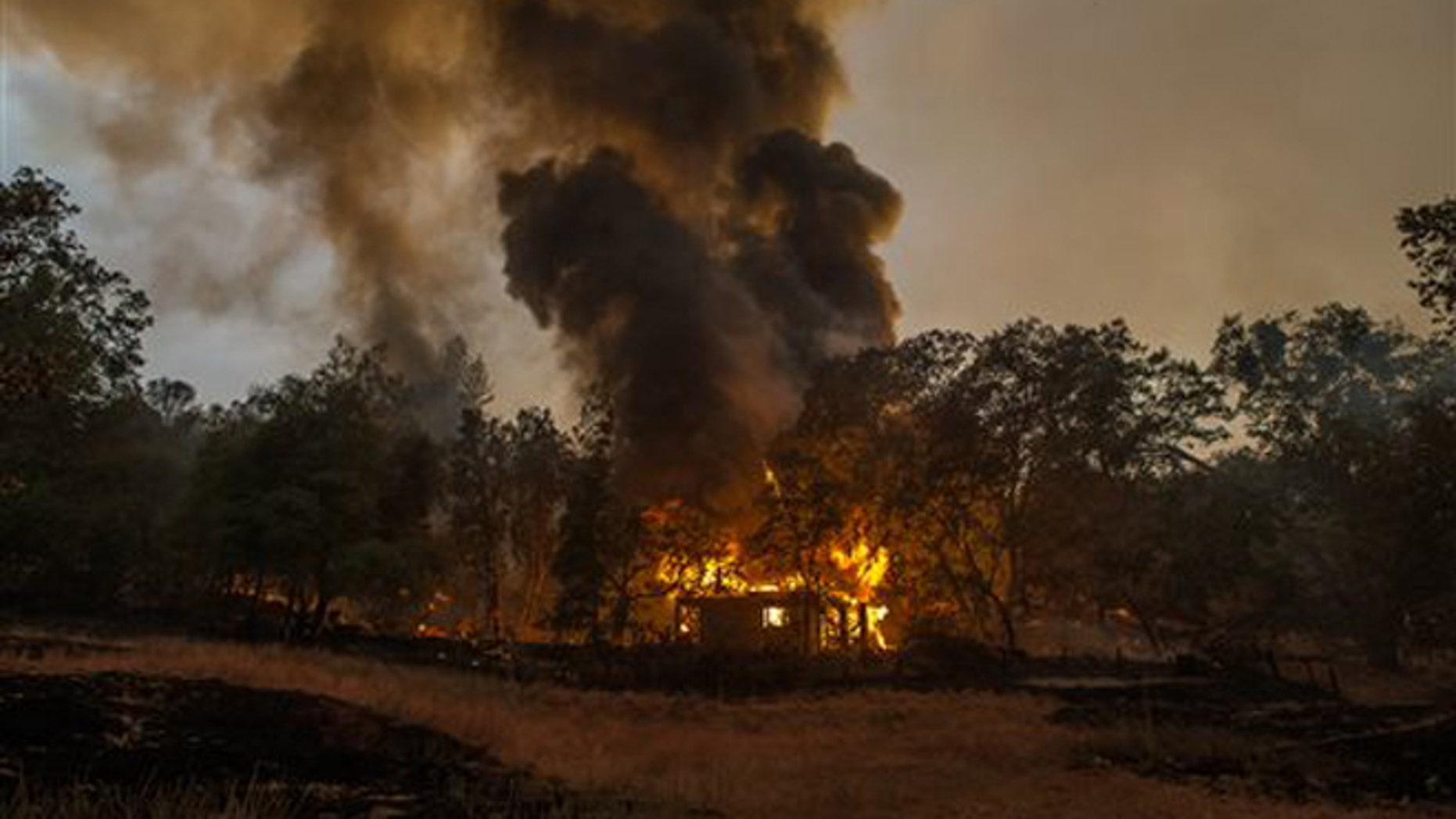Sept. 10, 2015: In this photo a home burns near Mokelumne Hill, in Jackson, Calif.