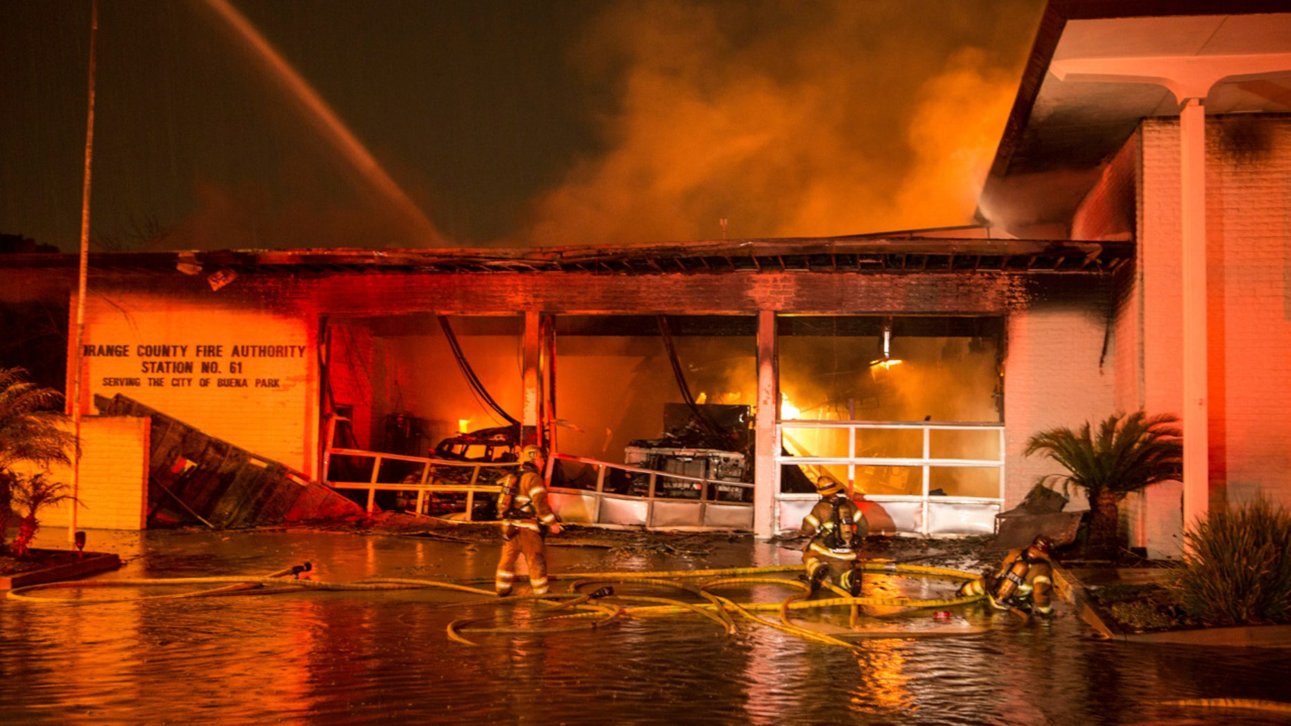 Firefighters battle a two alarm fire ripped through Orange County Fire Authority Station 6 in Buena Park, Calif. on Thursday, Jan. 12, 2017.