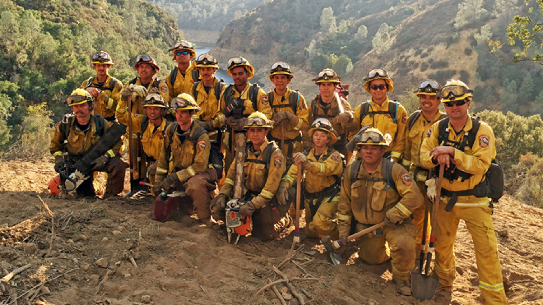 In this Aug. 15, 2016 photo provided by the California Conservation Corps, a civilian firefighter crew poses for a group photo during their deployment on the Chimney Fire in San Luis Obispo County, Calif.