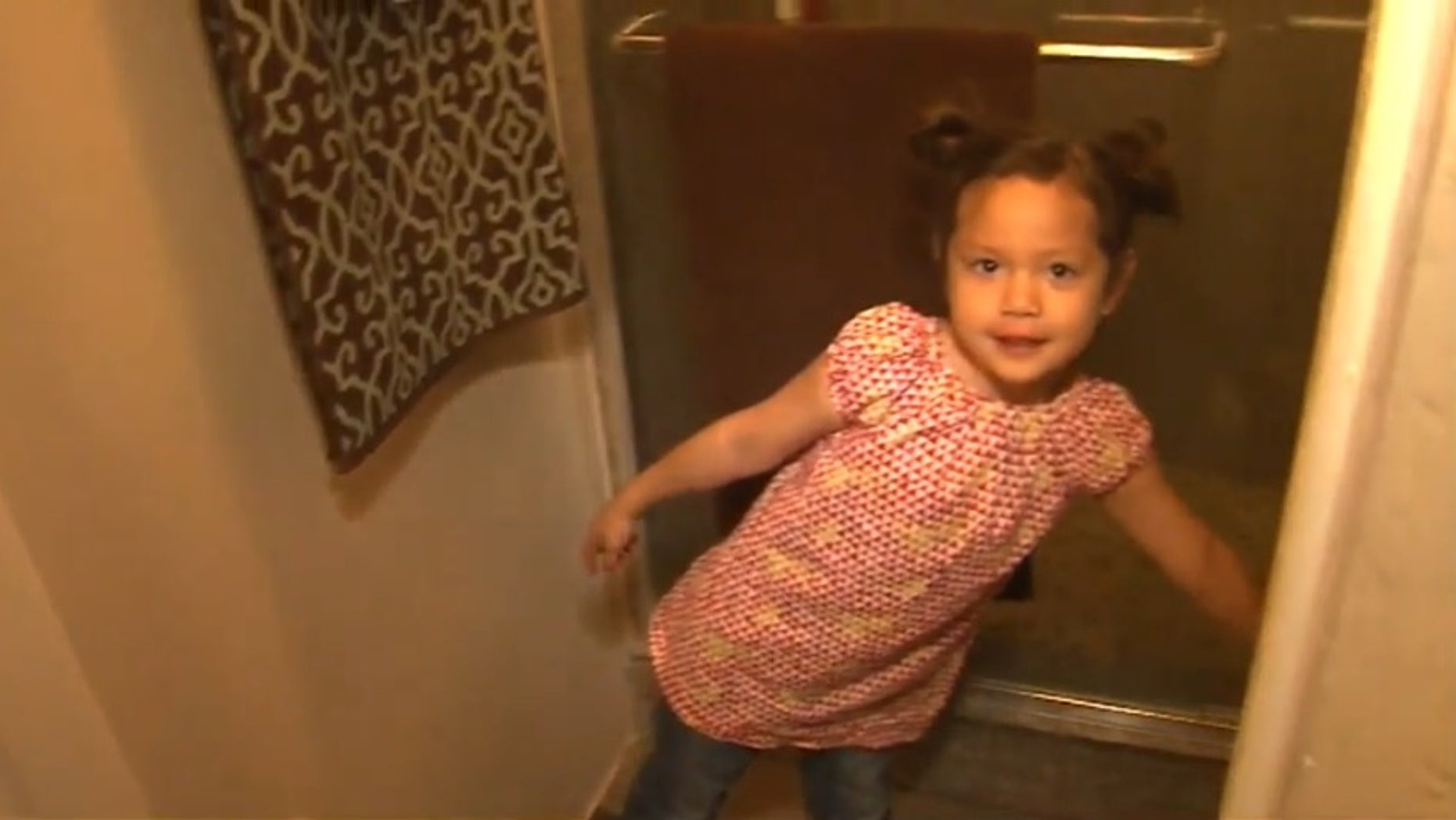 The 4-year-old girl pointing out where she hid.