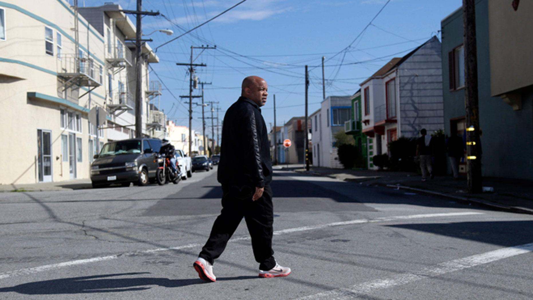 Feb. 13, 2014: Ernest Morgan walks around his neighborhood in San Francisco.