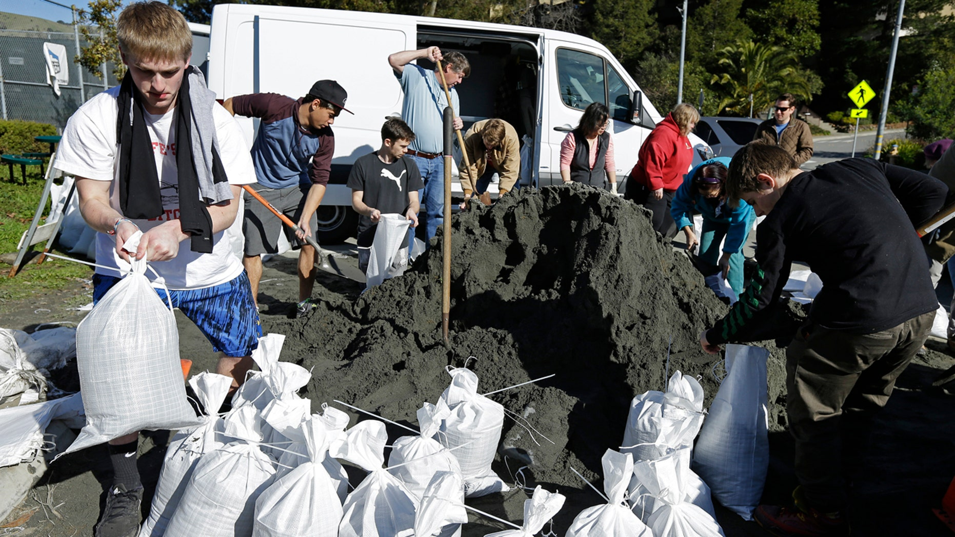 People load sand bags in preparation for a large storm on Friday, Jan. 6, 2017, in San Anselmo, Calif.