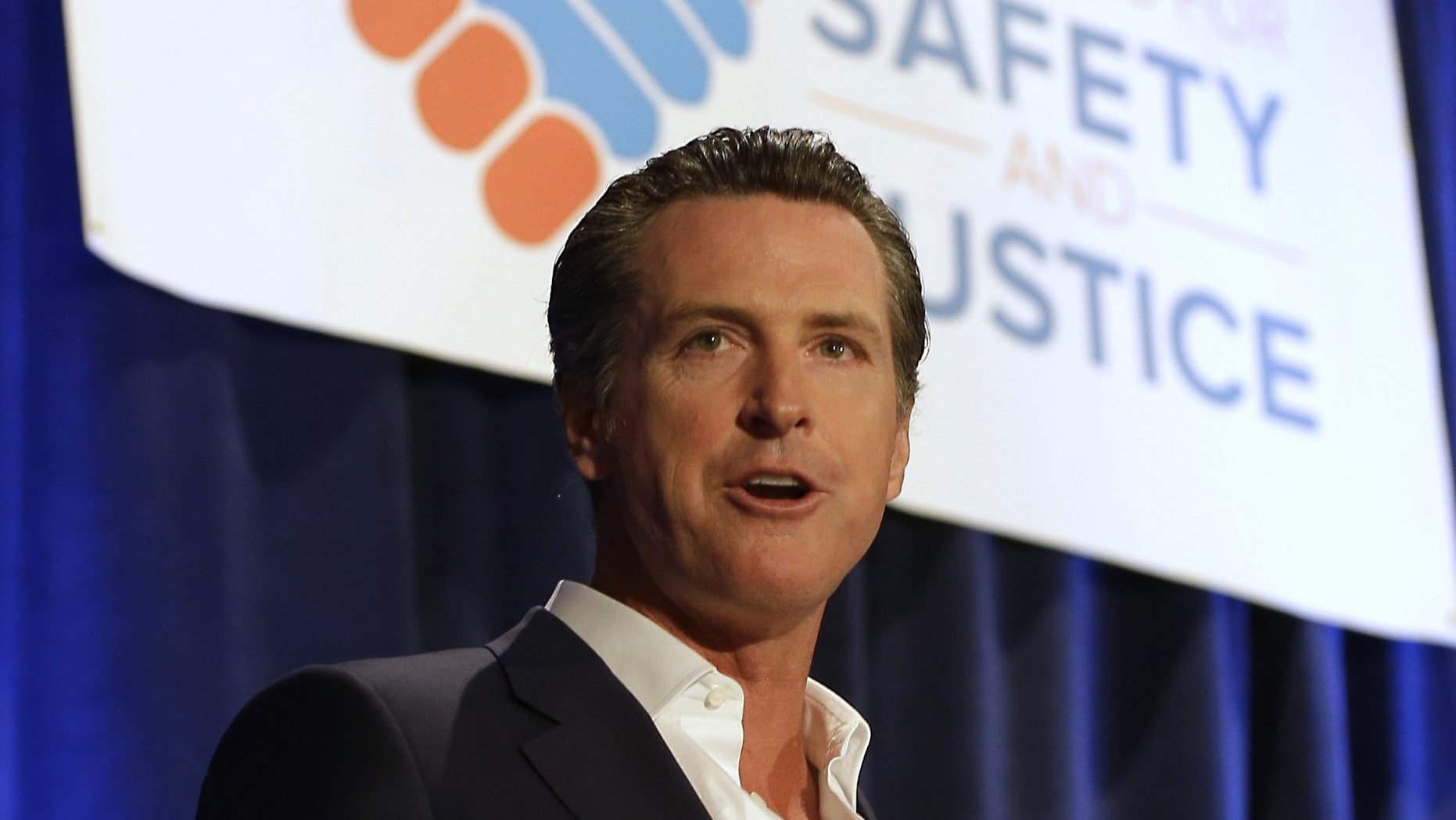 FILE - In this April 20, 2015, file photo, California Lt. Gov. Gavin Newsom speaks at the Californians for Safety and Justice conference in Sacramento, Calif.