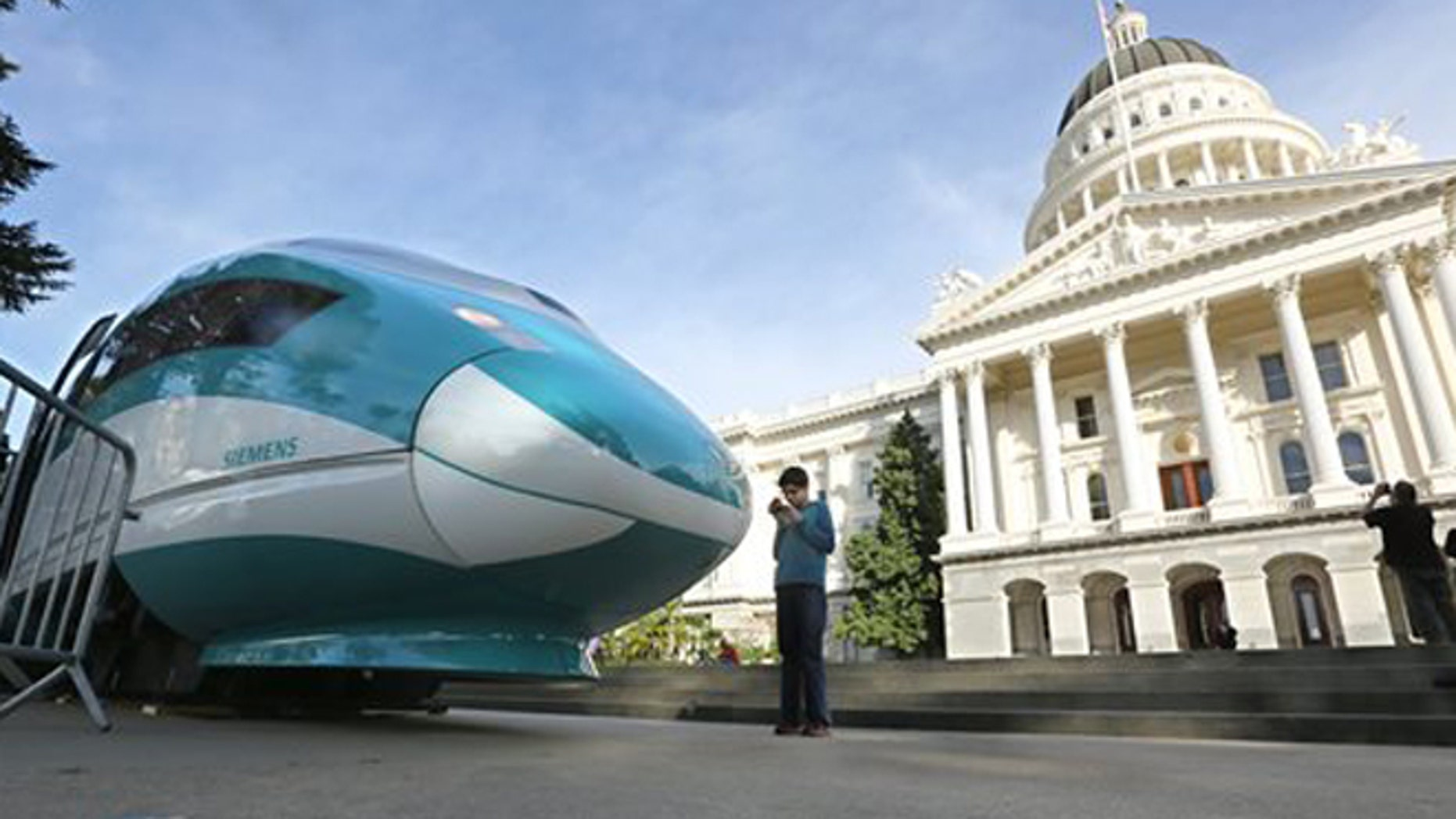 FILE - In this Feb. 26, 2015 file photo, a full-scale mock-up of a high-speed train is displayed at the Capitol in Sacramento, Calif. State officials will return to Sacramento Superior Court, Thursday, Feb. 11, 2016, to defend the project against critics who say high-speed rail cannot meet promises made to voters who approved a $9.9 billion bond measure to build it. (AP Photo/Rich Pedroncelli, File)