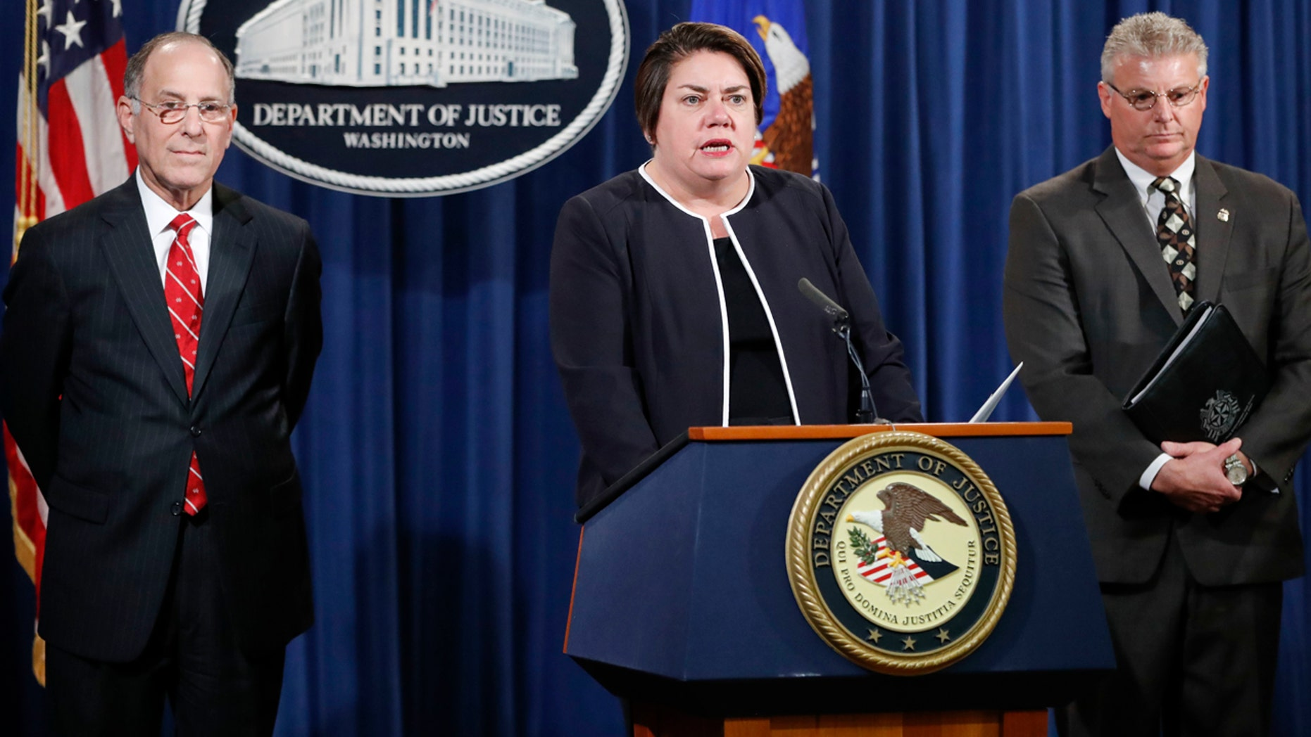 Oct. 27, 2016: Assistant Attorney General Leslie R. Caldwell, center, of the Criminal Division; Kenneth Magidson, left, of the Southern District of Texas; and Bruce M. Foucart, director, National Intellectual Property Rights Coordination Center, participate in a news conference at the Justice Department in Washington.