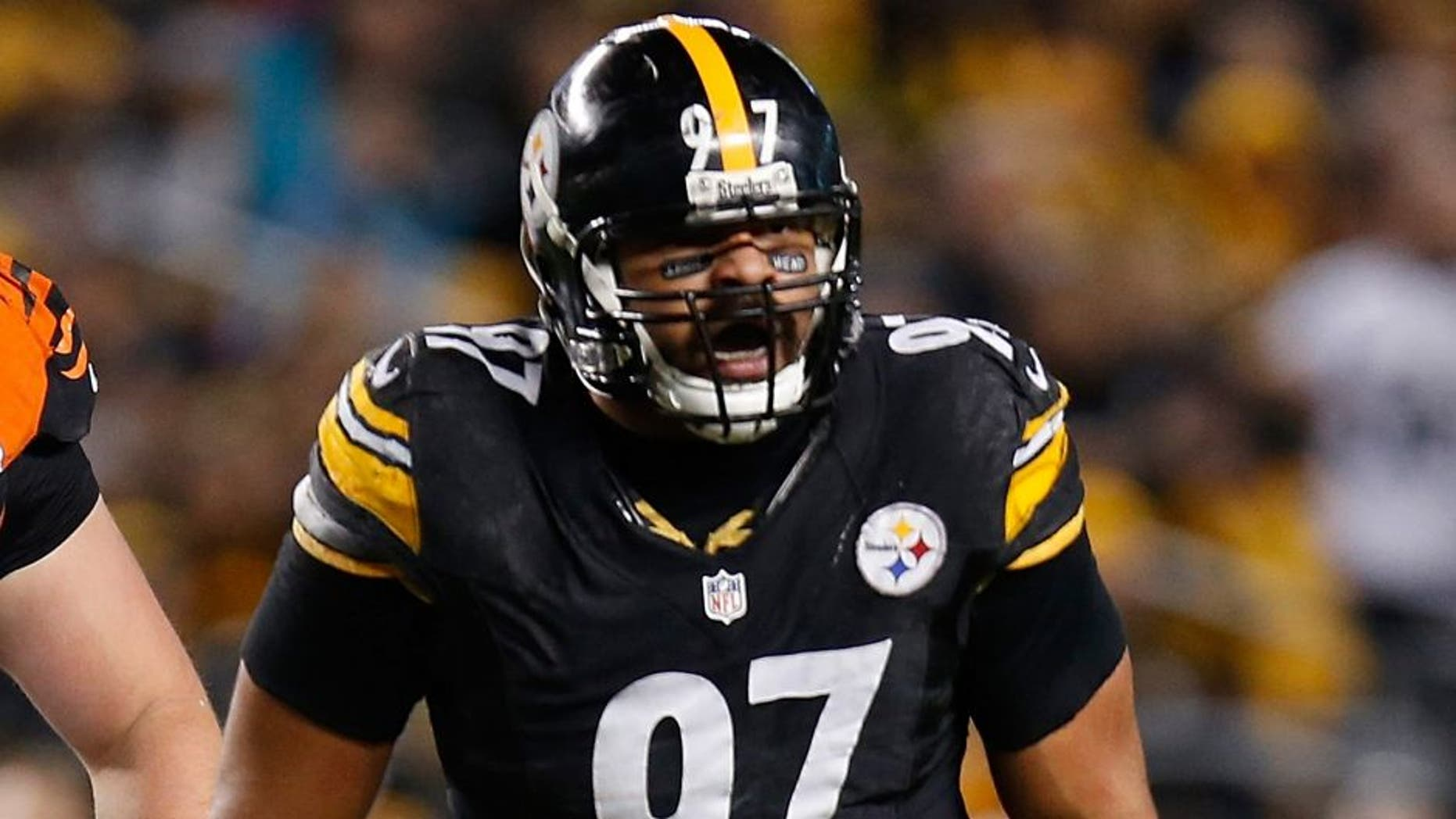 PITTSBURGH, PA - DECEMBER 28: Cameron Heyward #97 of the Pittsburgh Steelers reacts after sacking Andy Dalton #14 of the Cincinnati Bengals during the second quarter at Heinz Field on December 28, 2014 in Pittsburgh, Pennsylvania. (Photo by Gregory Shamus/Getty Images)
