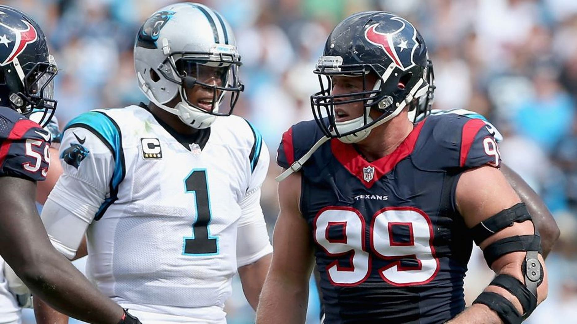 CHARLOTTE, NC - SEPTEMBER 20: Cam Newton #1 of the Carolina Panthers and J.J. Watt #99 of the Houston Texans in action during their game at Bank of America Stadium on September 20, 2015 in Charlotte, North Carolina. (Photo by Streeter Lecka/Getty Images)
