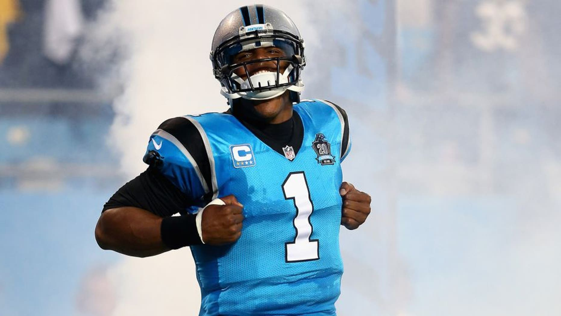 CHARLOTTE, NC - SEPTEMBER 21: Cam Newton #1 of the Carolina Panthers makes his entrance against the Pittsburgh Steelers during the game at Bank of America Stadium on September 21, 2014 in Charlotte, North Carolina. (Photo by Streeter Lecka/Getty Images)