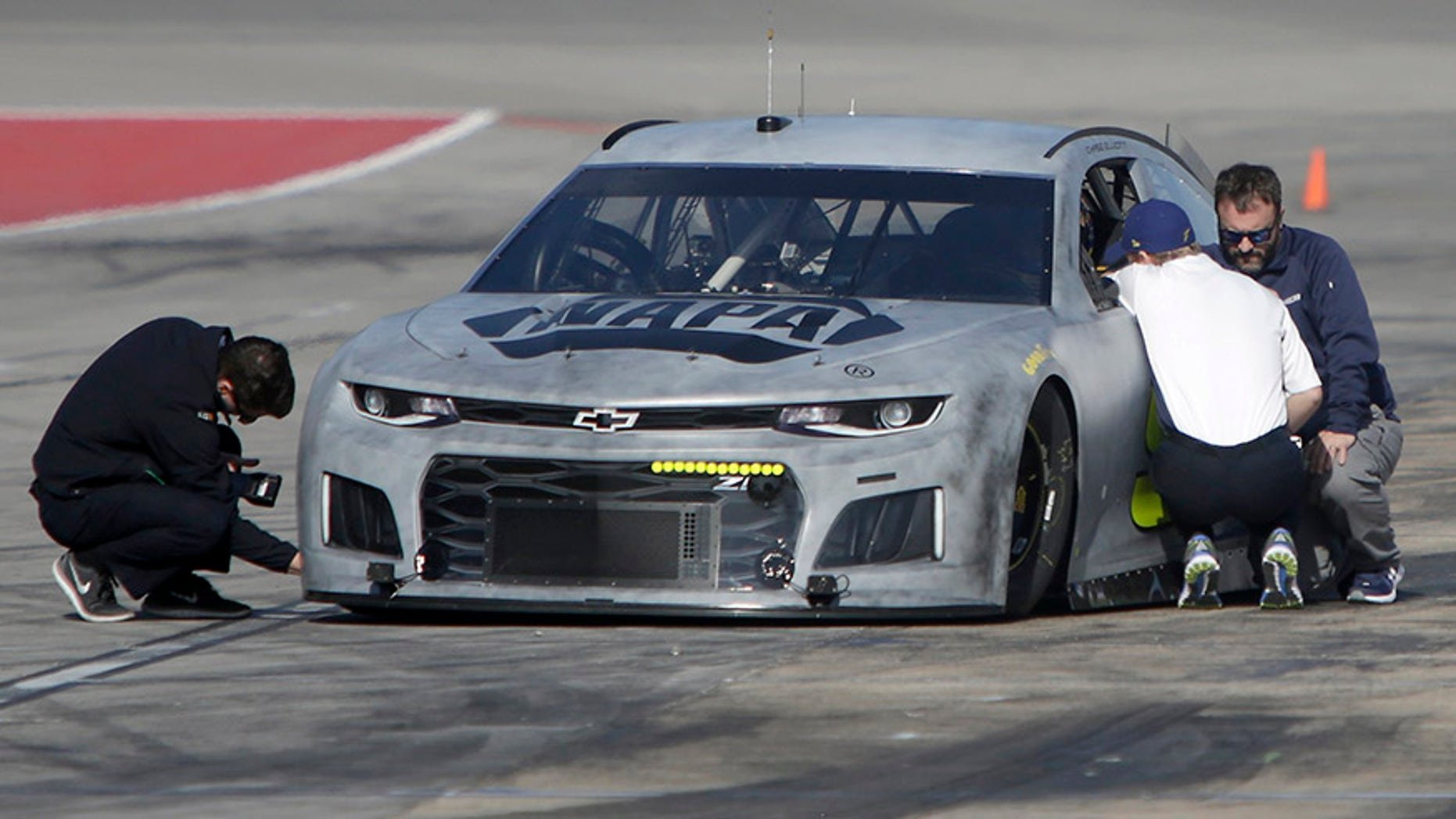Chase Elliott pulls in to pit row while participating in NASCAR tire tests at Texas Motor Speedway in Fort Worth, Texas, Tuesday, Jan. 9, 2018. (Brad Loper/Star-Telegram via AP)