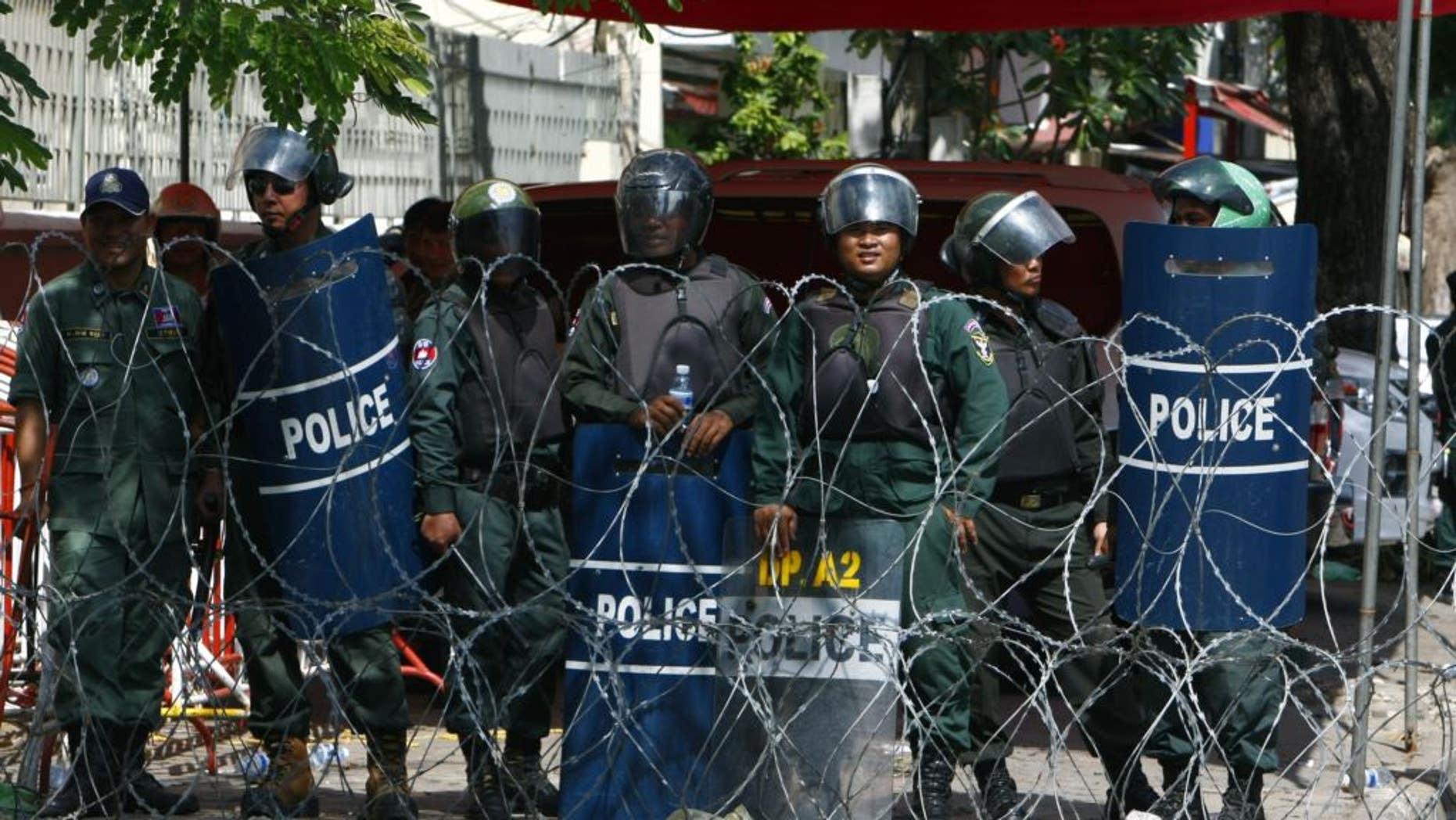 Riot police in Phnom Penh, Cambodia, in 2014.