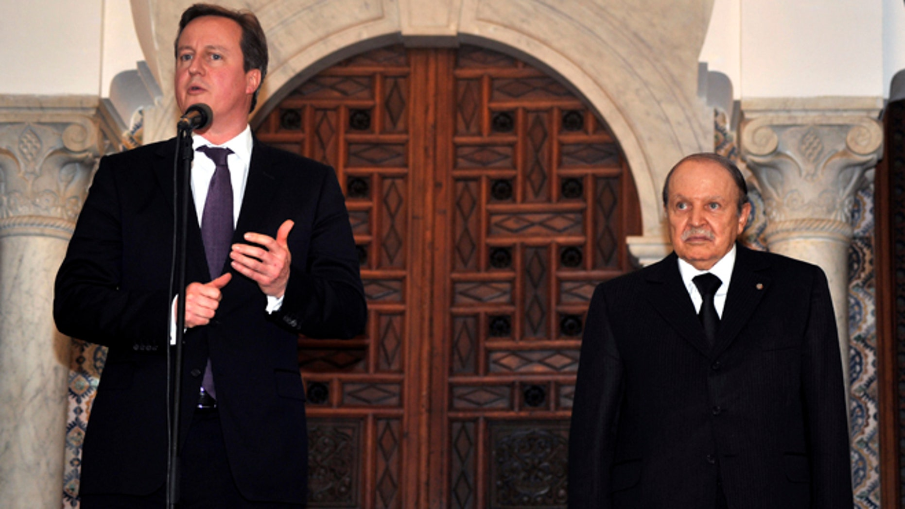 Jan. 30, 2013: Algerian President Abdelaziz Bouteflika, right, listens to Britain's Prime Minister David Cameron as he delivers a speech in Algiers, Wednesday. Britain and Algeria agreed to a security partnership that could see greater intelligence-sharing and planning for future crises, Cameron said Wednesday on a visit to the North African country.