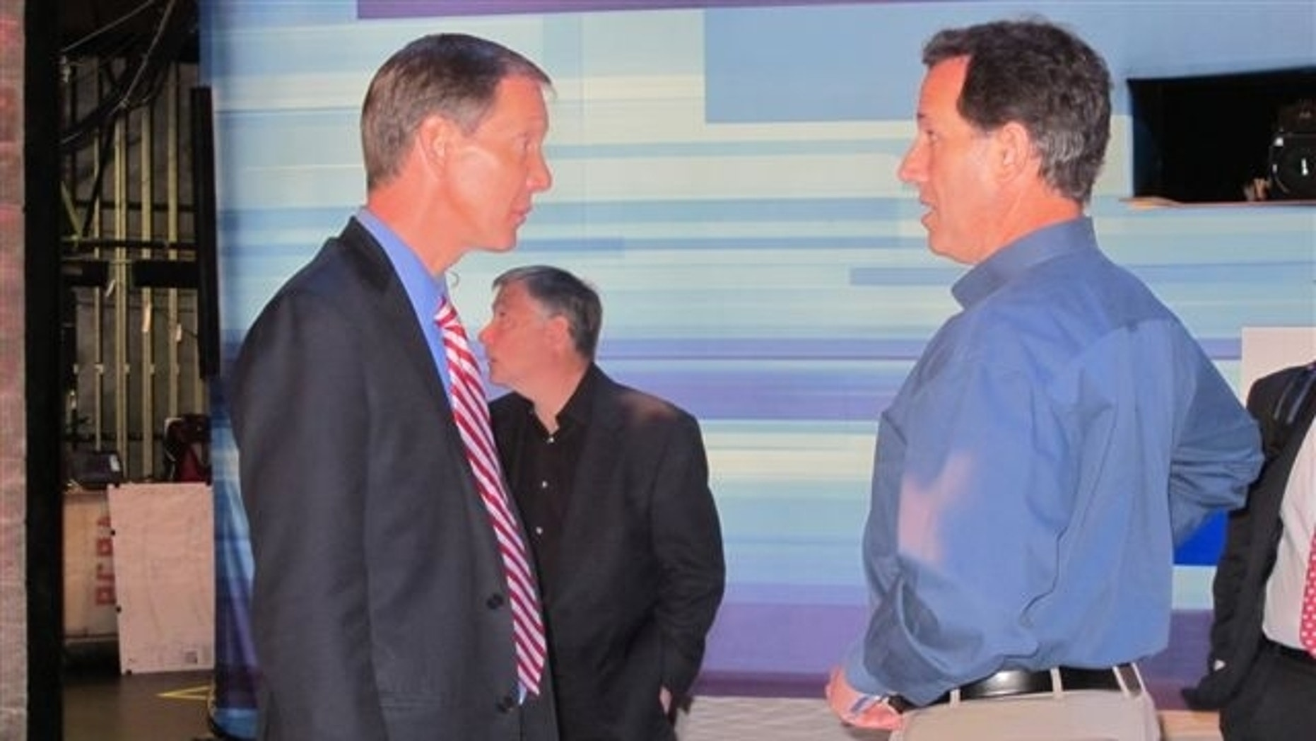 Fox News Chief Political Correspondent Carl Cameron talks with former Sen. Rick Santorum, R-Pa., on the stage of Thursday's GOP debate in Greenville, S.C.  (Fox News Photo / Katy Ricalde)