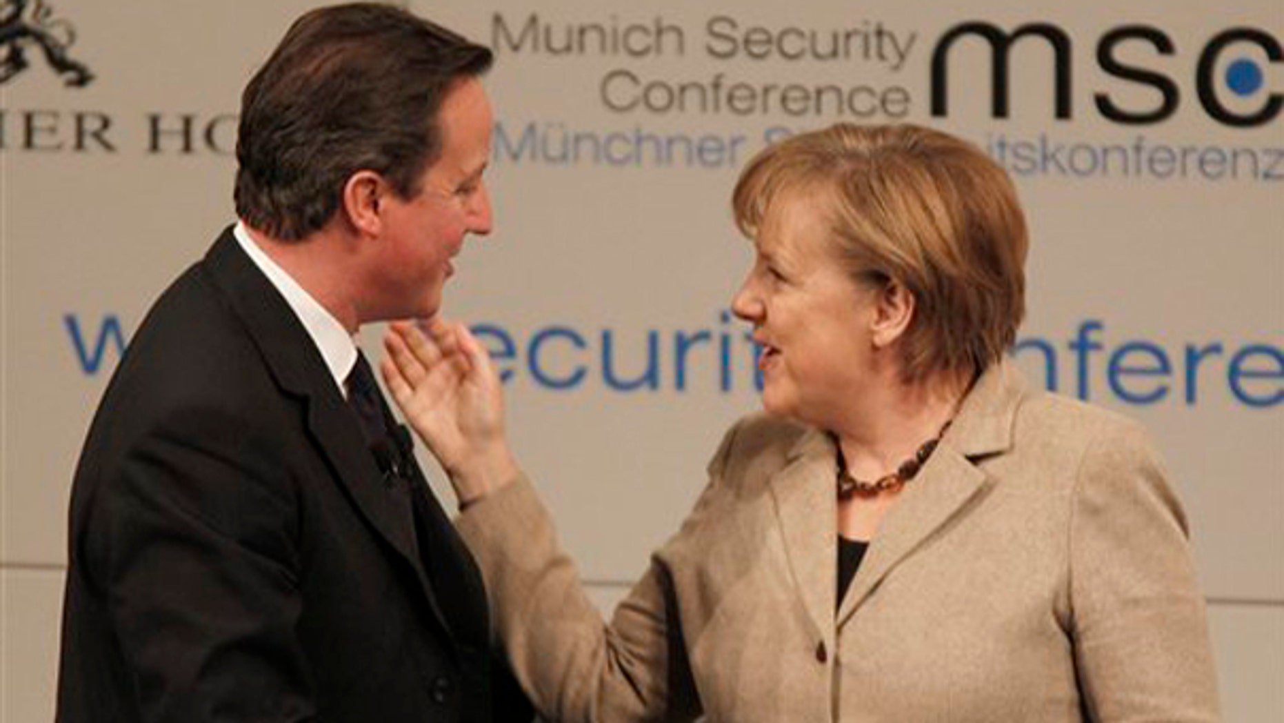 Saturday: British Prime Minister David Cameron chats with German Chancellor Angela Merkel after attending a panel discussion during the Conference on Security Policy in Munich, Germany.