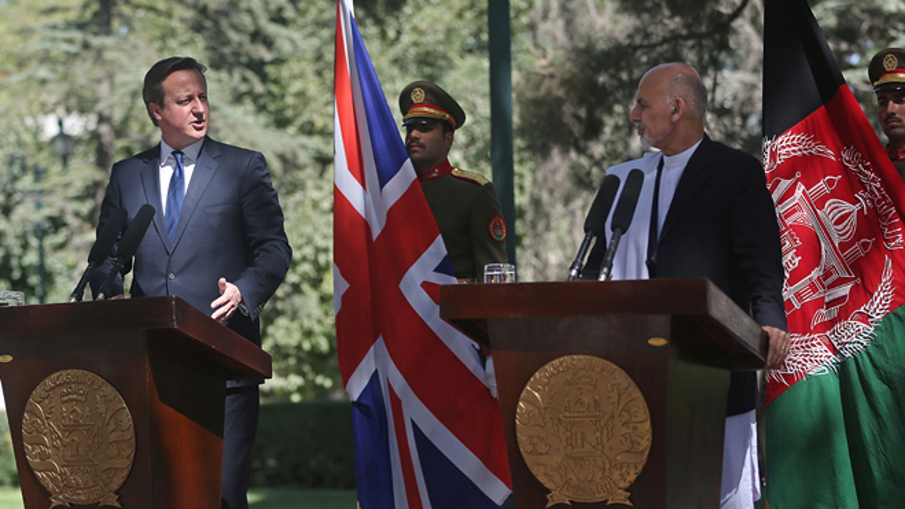 Oct. 3, 2014: Afghanistan's president Ashraf Ghani Ahmadzai, second right, listens as Britain's Prime Minister David Cameron talks during a news conference at the presidential palace in Kabul, Afghanistan. (AP)