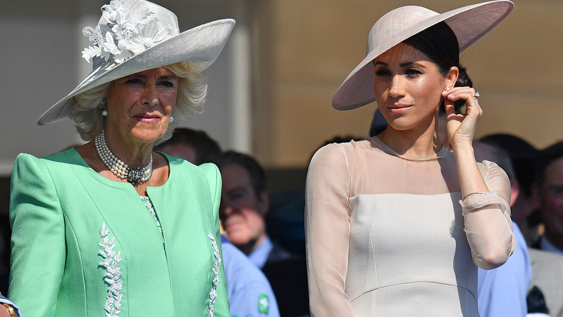 Meghan, the Duchess of Sussex, right, stands with Camilla, the Duchess of Cornwall, during a garden party at Buckingham Palace in London, Tuesday May 22, 2018. The event is part of the celebrations to mark the 70th birthday of Prince Charles.