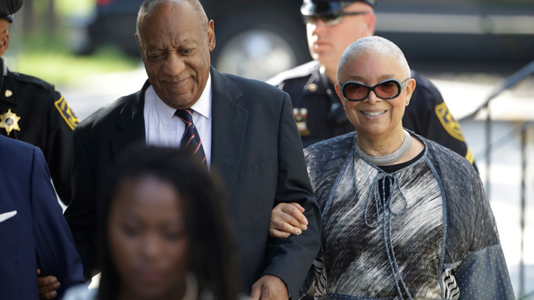 Bill Cosby arrives for his sexual assault trial with his wife Camille Cosby, right, at the Montgomery County Courthouse in Norristown, Pa., Monday, June 12, 2017.