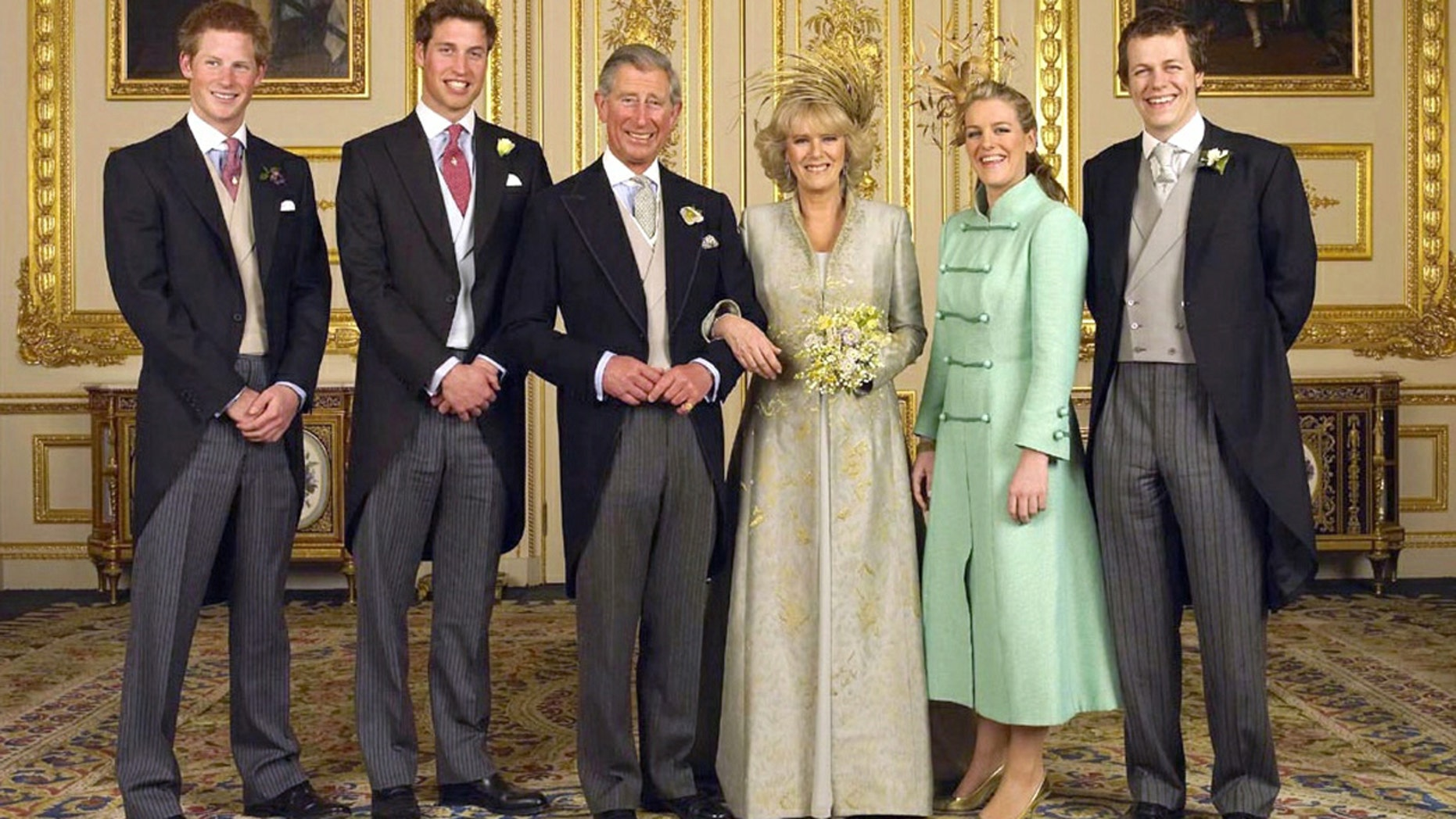 Prince Charles and Camilla Parker Bowles are pictured on their wedding with all of their children (L-R) Prince Harry, Prince William, Laura and Tom Parker Bowles, in the White Drawing Room at Windsor Castle, April 10, 2005.