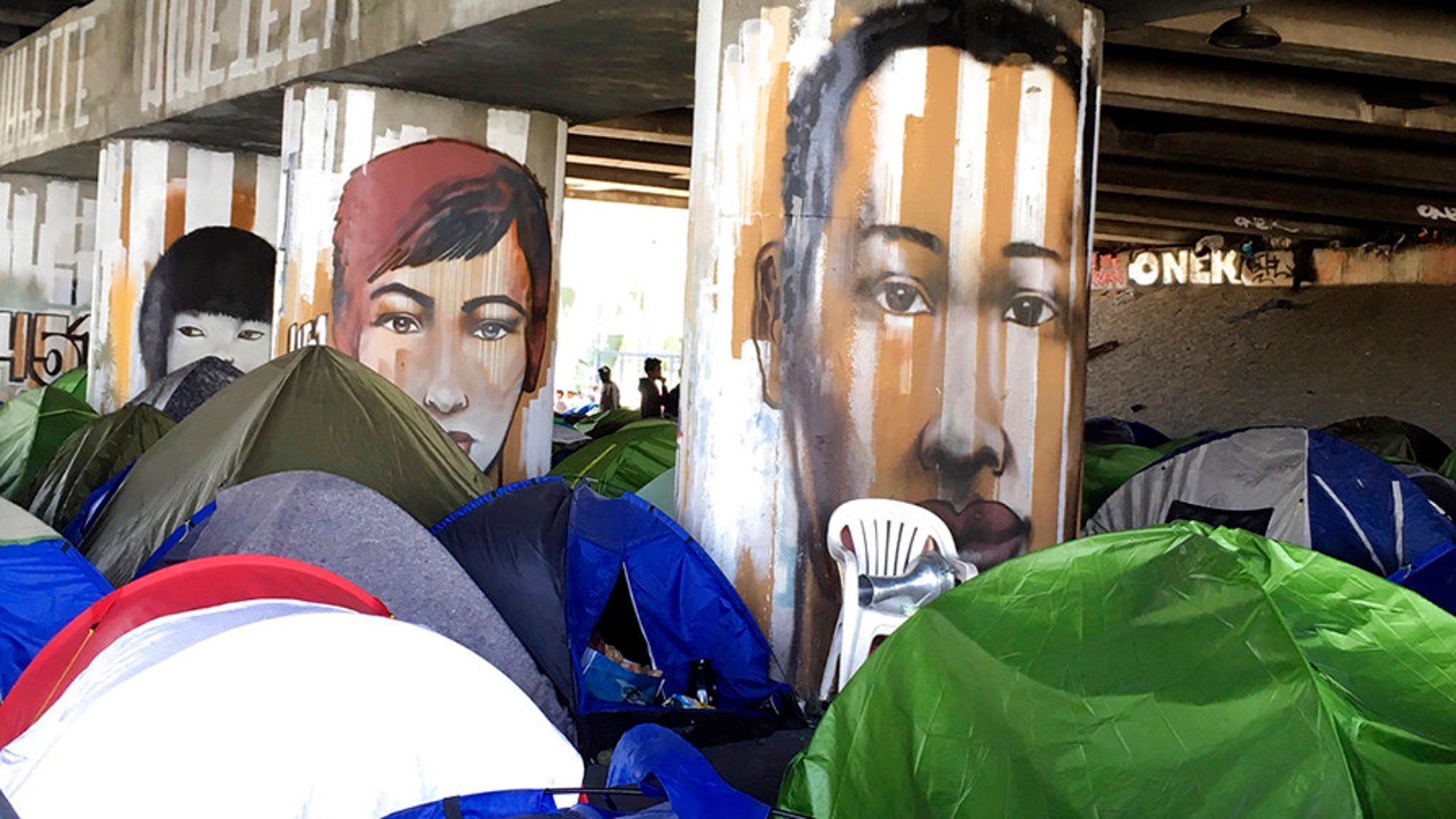 The French government is looking to evacuate two migrant camps near Paris