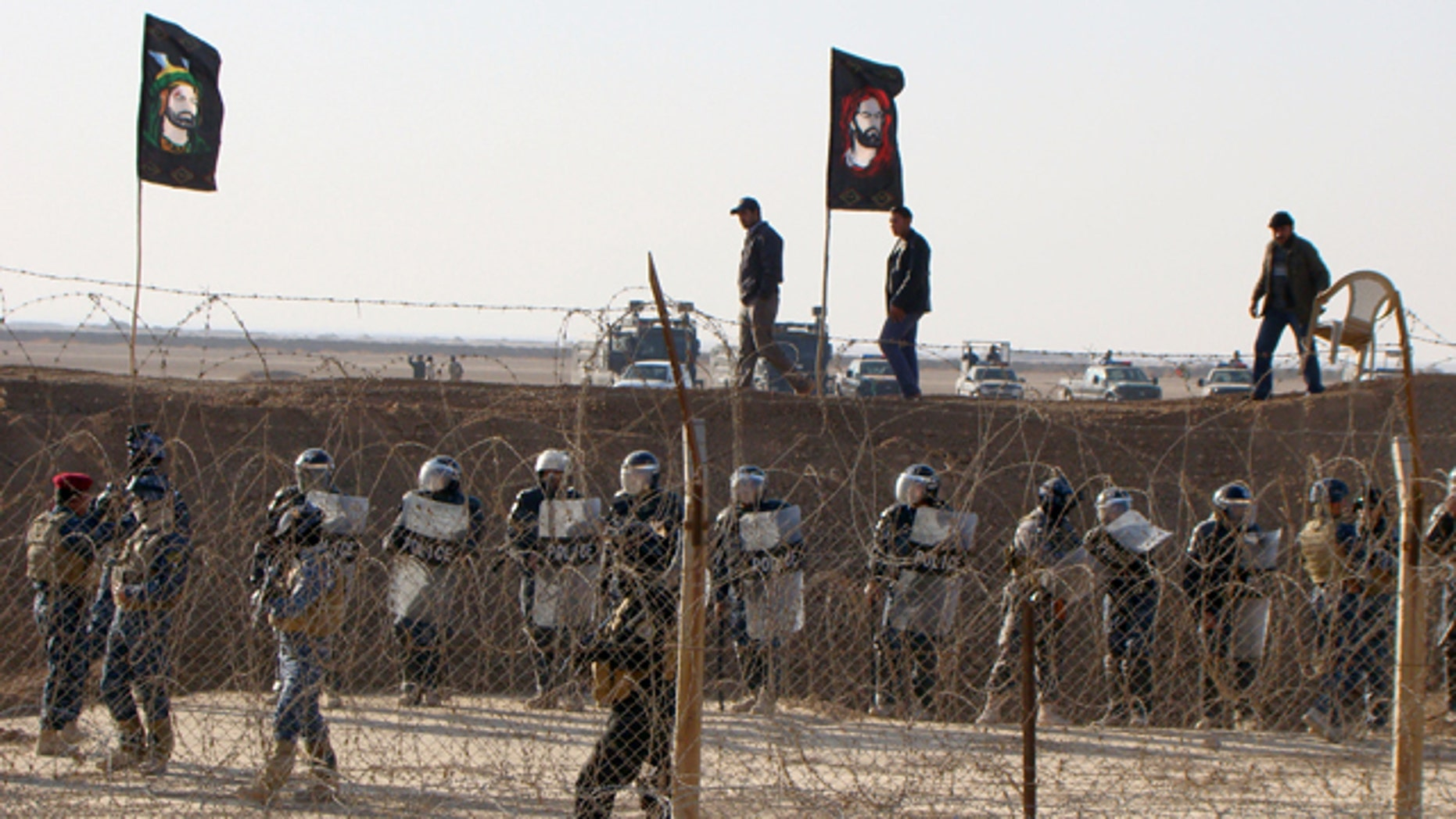 Dec. 9, 2011: In this photo provided by the People's Mujahedeen Organization of Iran, Iraqi police stand guard outside the opposition group's camp northeast of Baghdad, Iraq.