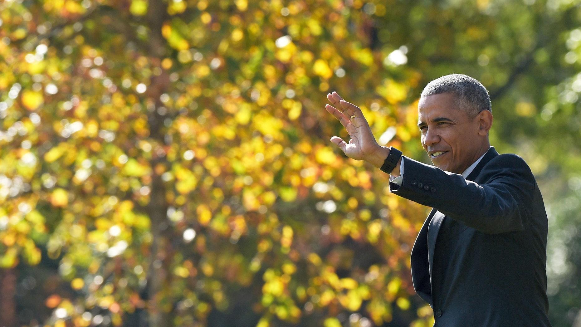 President Barack Obama waves as he walks towards Marine One.