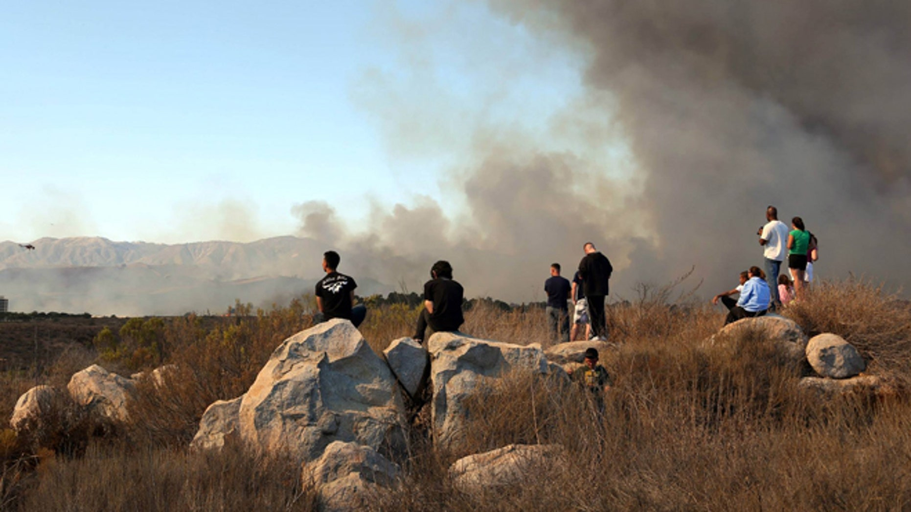 Oct. 5, 2013: This photo provided by the U.S. Marine Corps Base Camp Pendleton shows fire burning in the Lake O'Neill vicinity on Camp Pendleton, Calif. This brush fire at Camp Pendleton has burned more than 1,500 acres and forced evacuation of a military housing area and the base hospital. (AP/USMC, Cpl. Sarah Wolff Diaz)