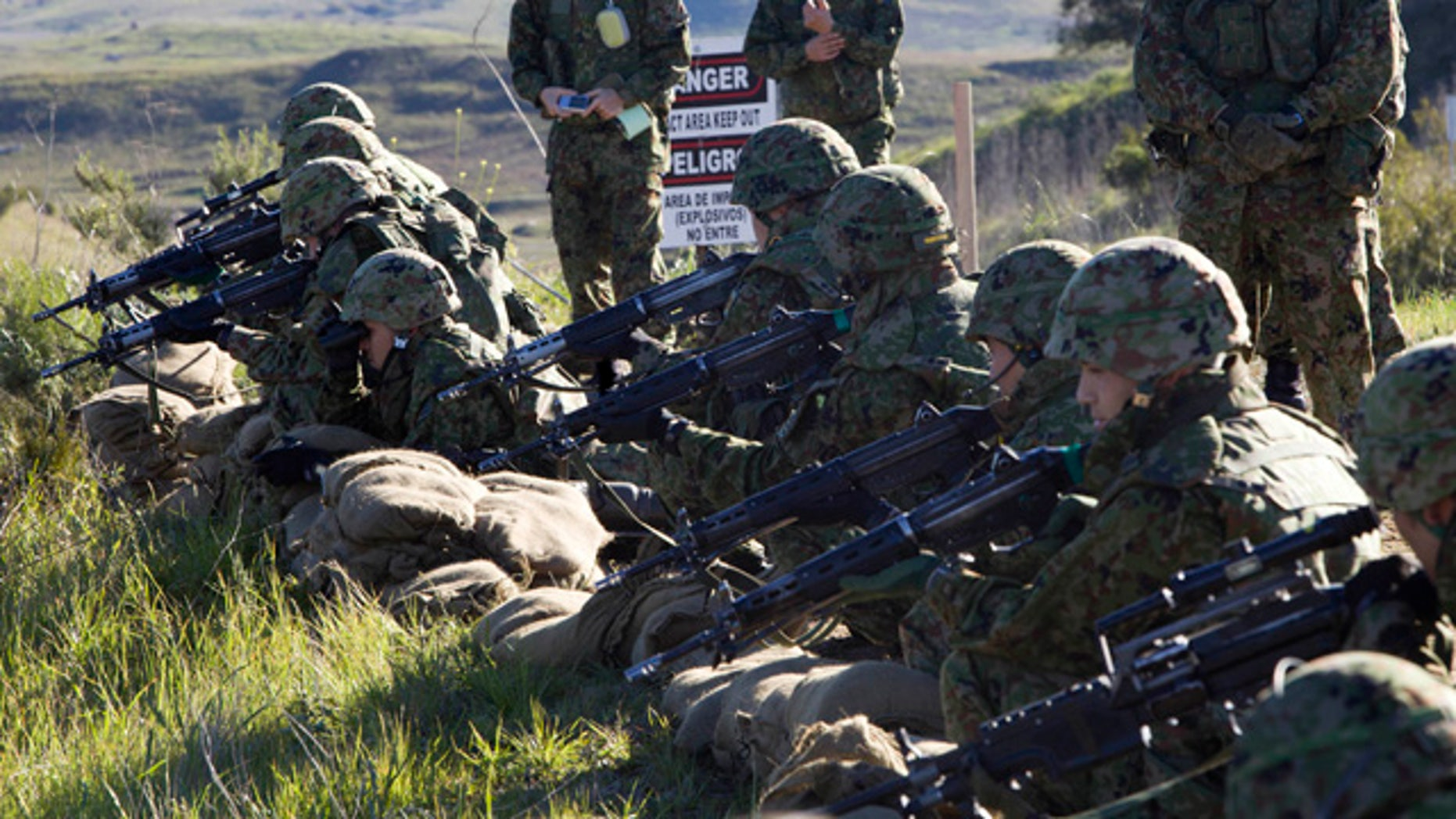 "Japan Ground Self-Defense Force (JGSDF) soldiers and the Western Army Infantry Regiment participate in a live exercise during ""Iron Fist 2012"" at Marine Corps Base Camp Pendleton, California."