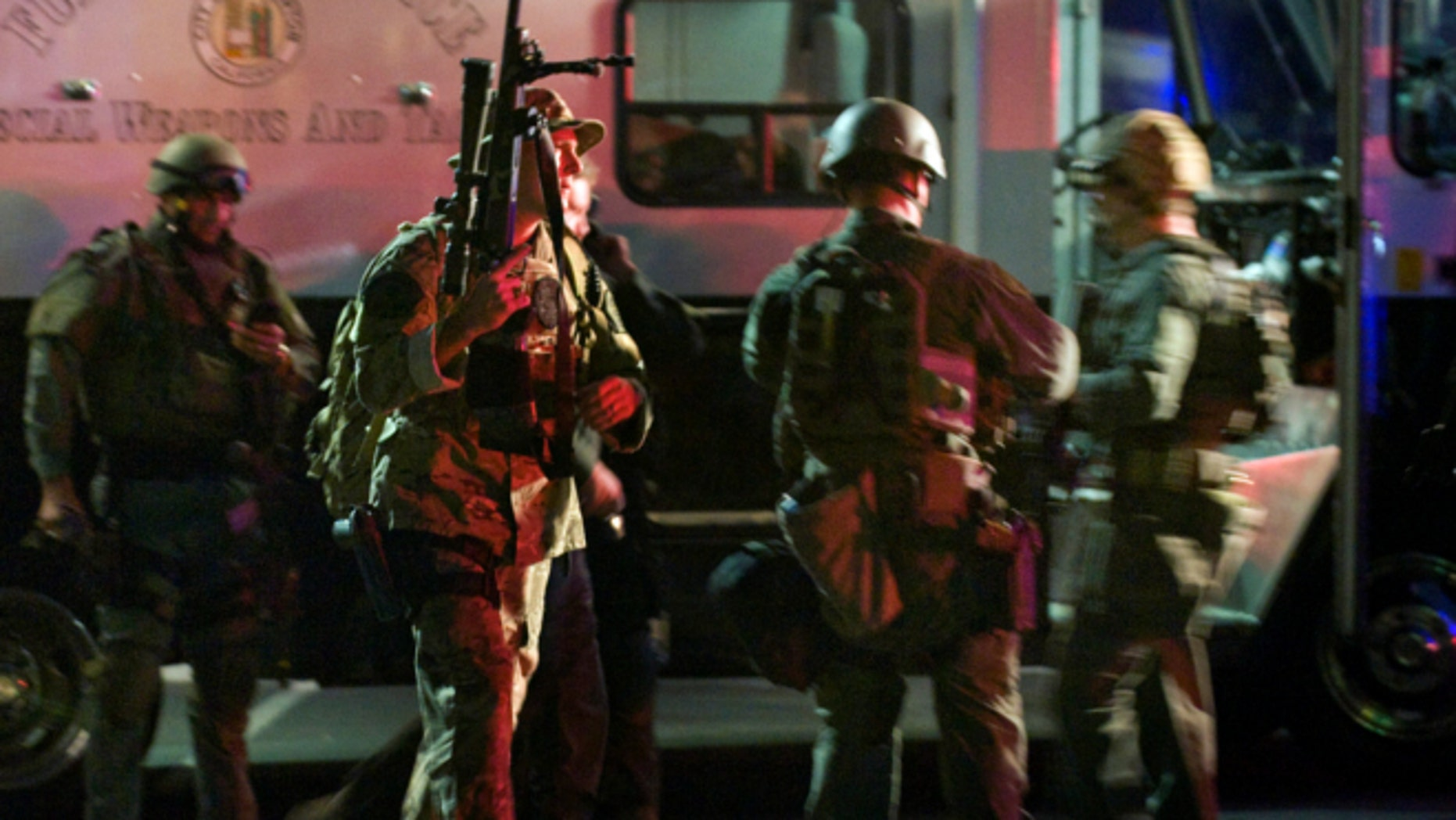 Dec. 12, 2012: SWAT team members form up near a command post south of the Cal State Fullerton campus in Fullerton, Calif.