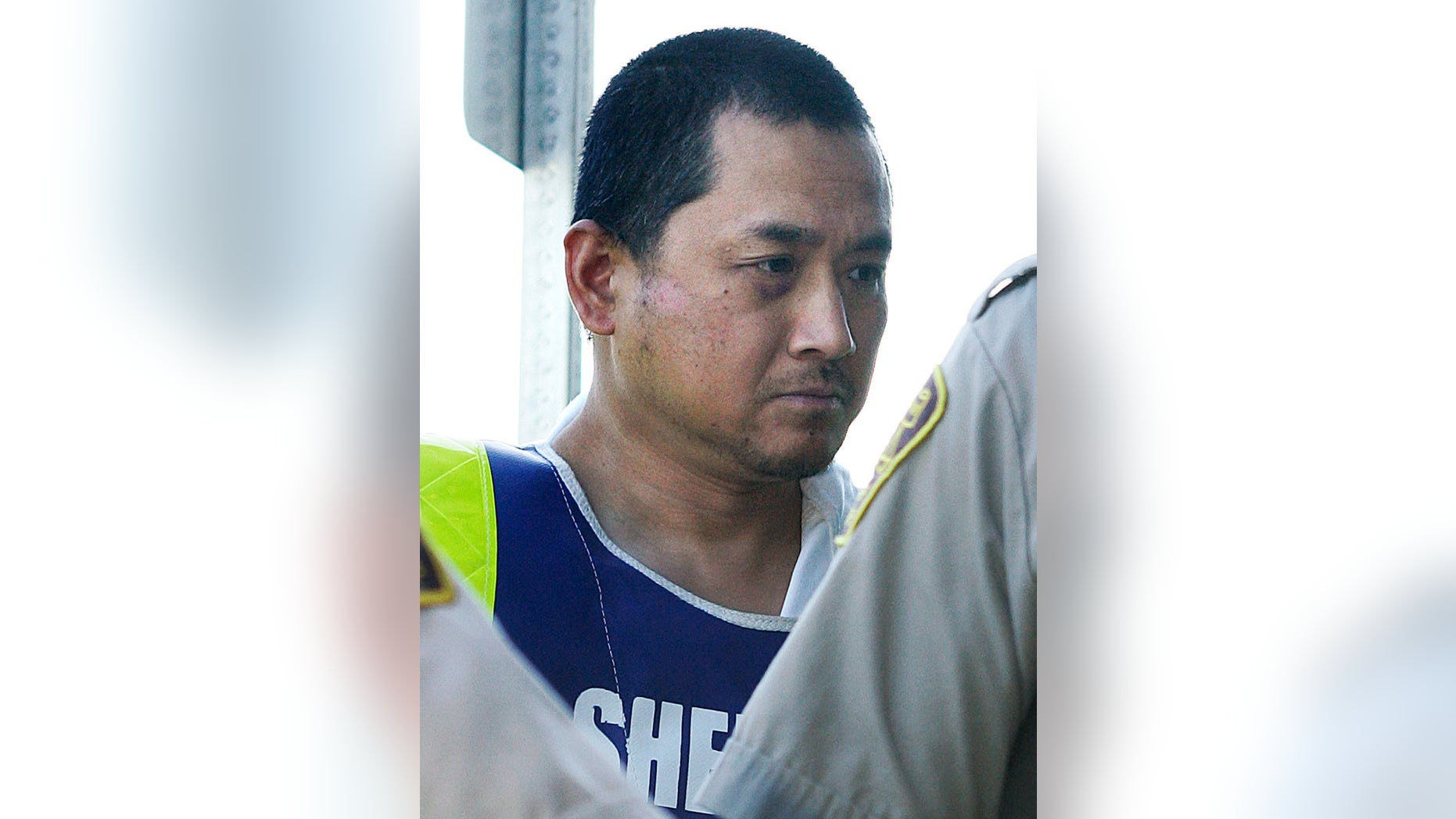 File- This Aug. 5, 2008, file photo shows Vince Li. Li, who was found not criminally responsible for beheading and cannibalizing a fellow passenger on a Greyhound bus has been granted his freedom. Manitoba's Criminal Code Review Board announced Friday, Feb. 10, 2017,  it has given Will Baker, formerly known as Vince Li, an absolute discharge, meaning he is longer subject to monitoring.  (John Woods/The Canadian Press via AP, File)