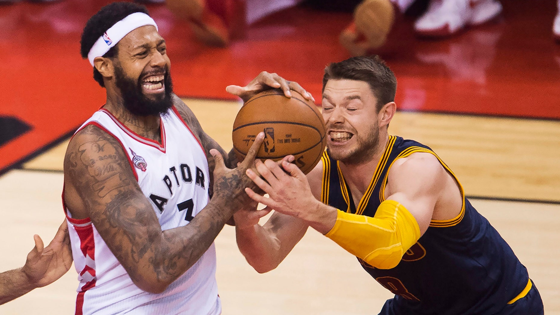 May 23, 2016: Toronto Raptors forward James Johnson (3) battles for the ball against Cleveland Cavaliers guard Matthew Dellavedova (8) during first half Eastern Conference final playoff basketball action in Toronto.