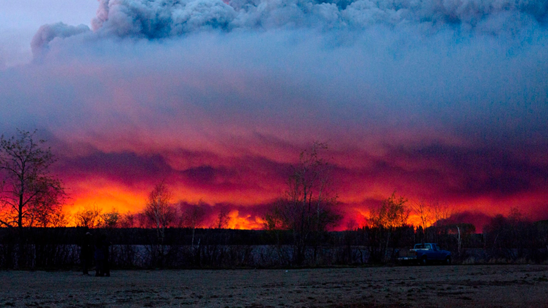 May 4, 2016: A wildfire moves towards the town of Anzac from Fort McMurray, Alberta.